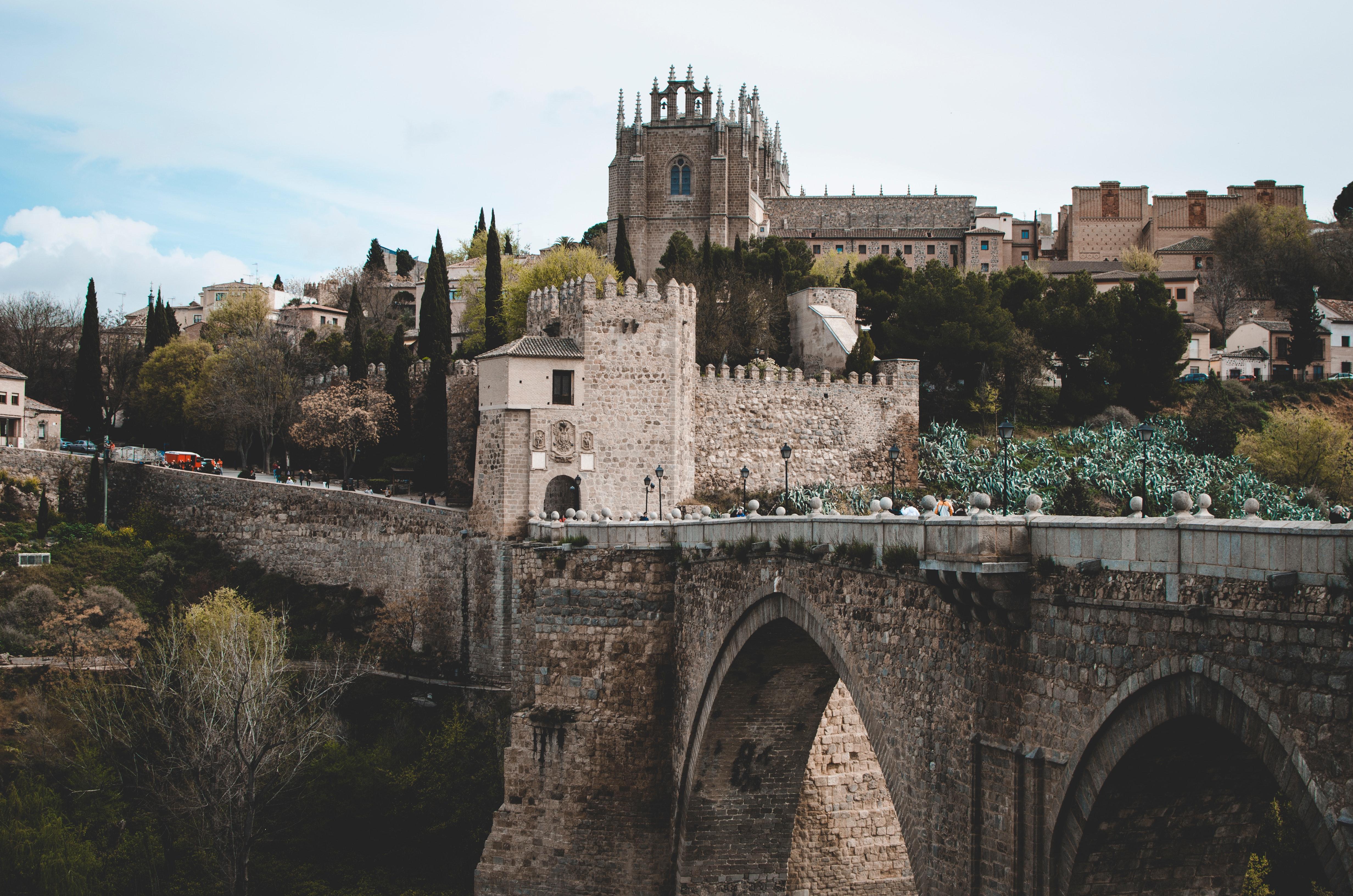Photo of gray castle and bridge