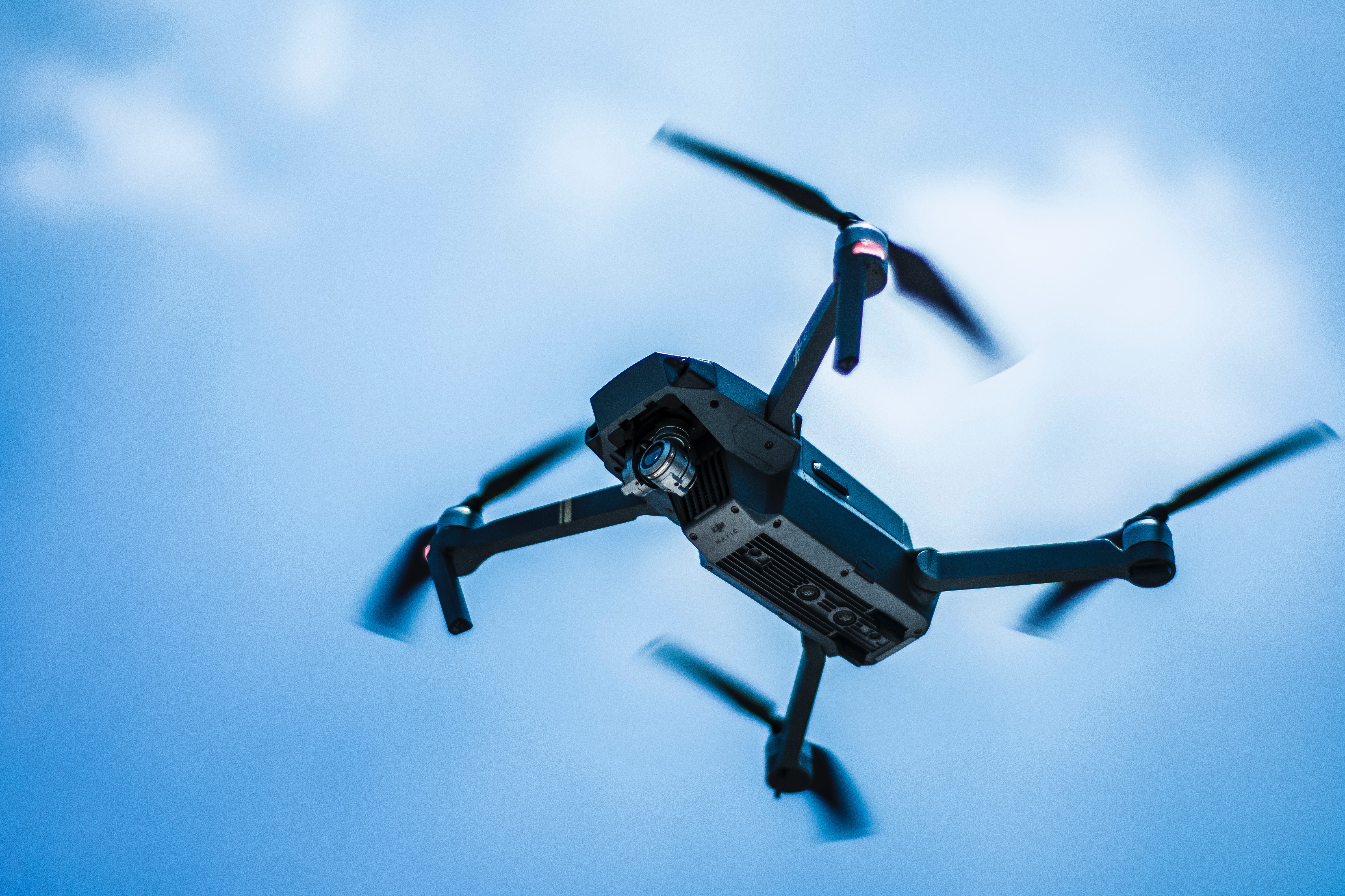 Photo of gray quadcopter on the sky