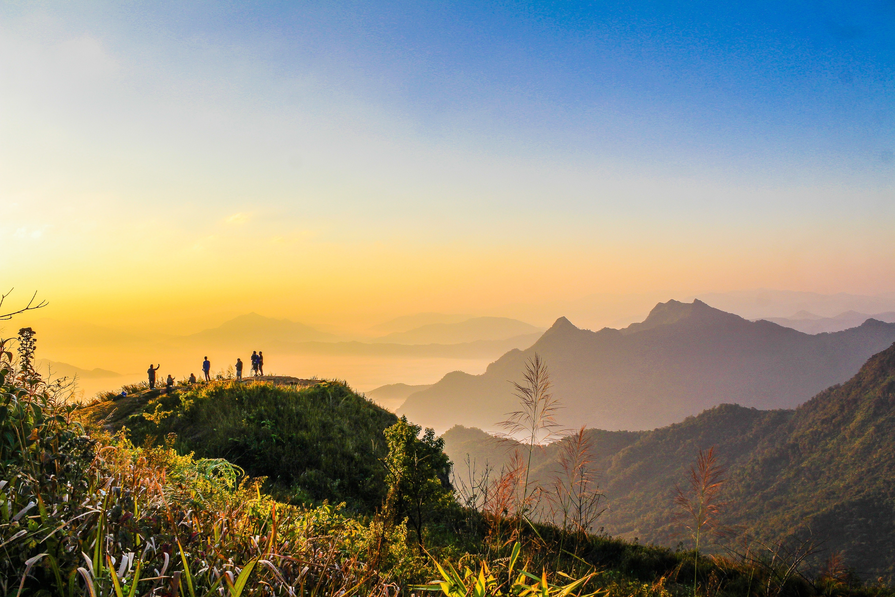 Photo of People Standing on Top of Mountain Near Grasses Facing Mountains during Golden Hours, Adventure, Summer, North, Outdoors, HQ Photo