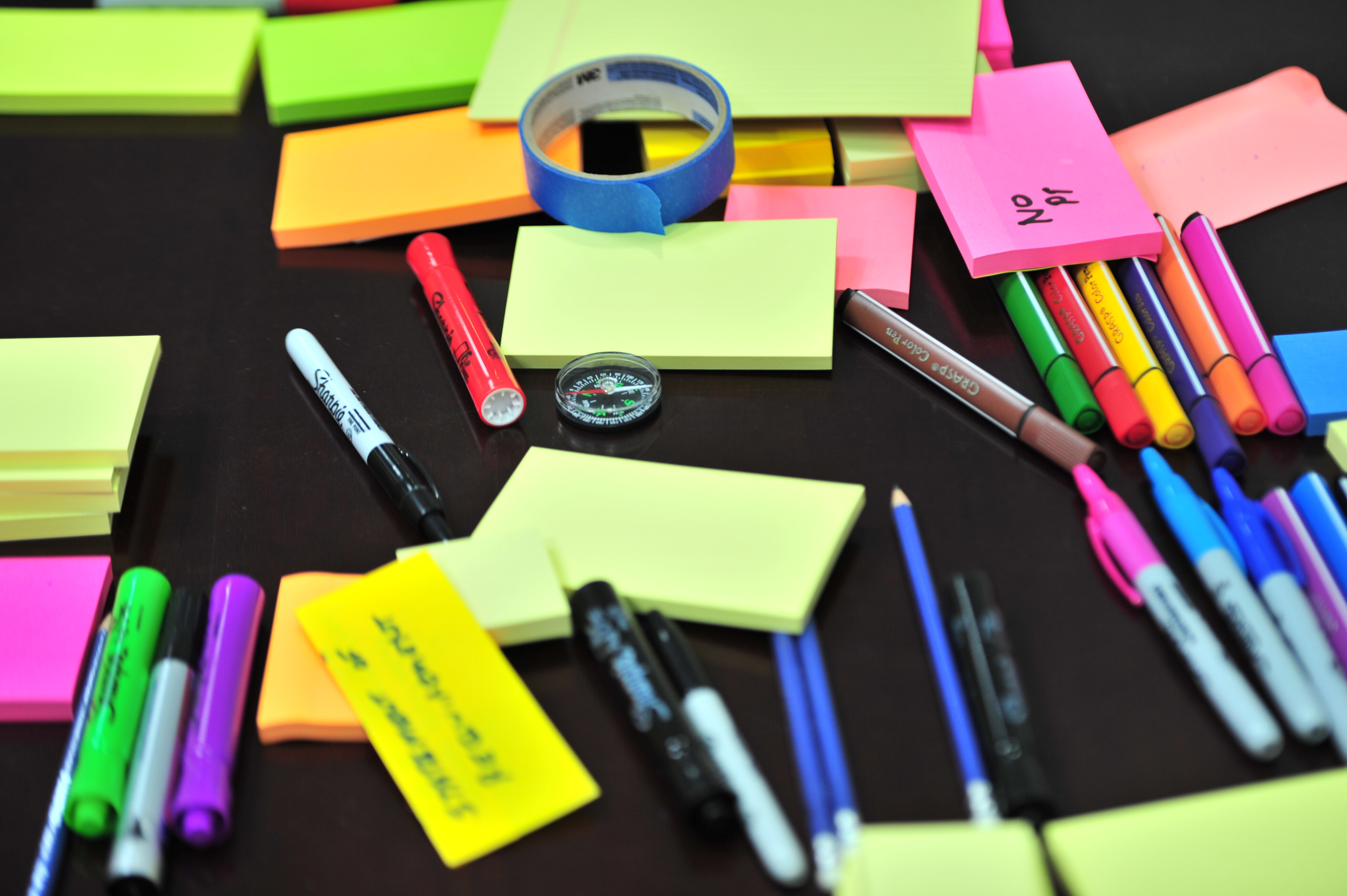 Photo of Sticky Notes and Colored Pens Scrambled on Table, Art, Office, Write, Table, HQ Photo