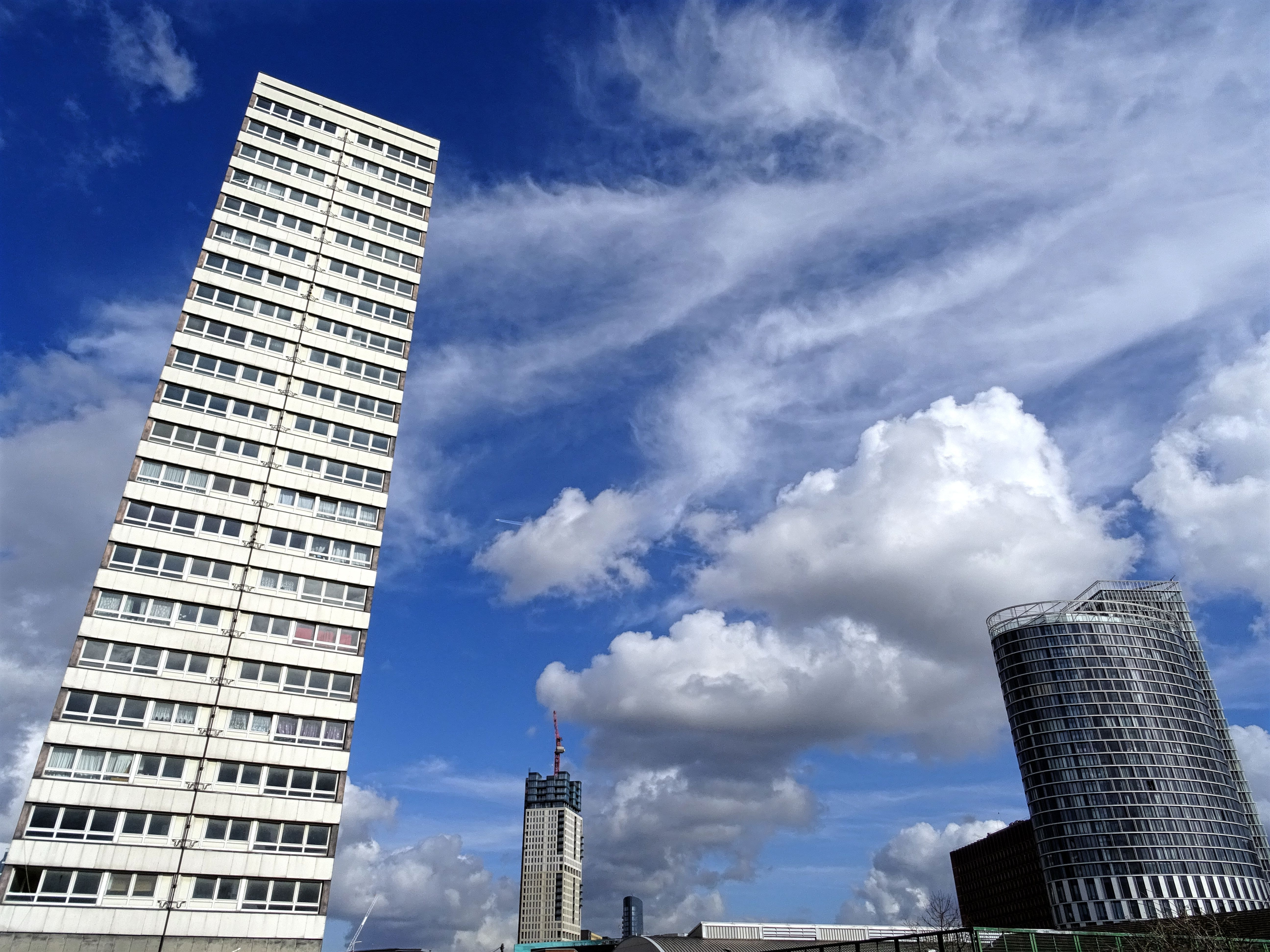 Photo of two white and black high rise buildings