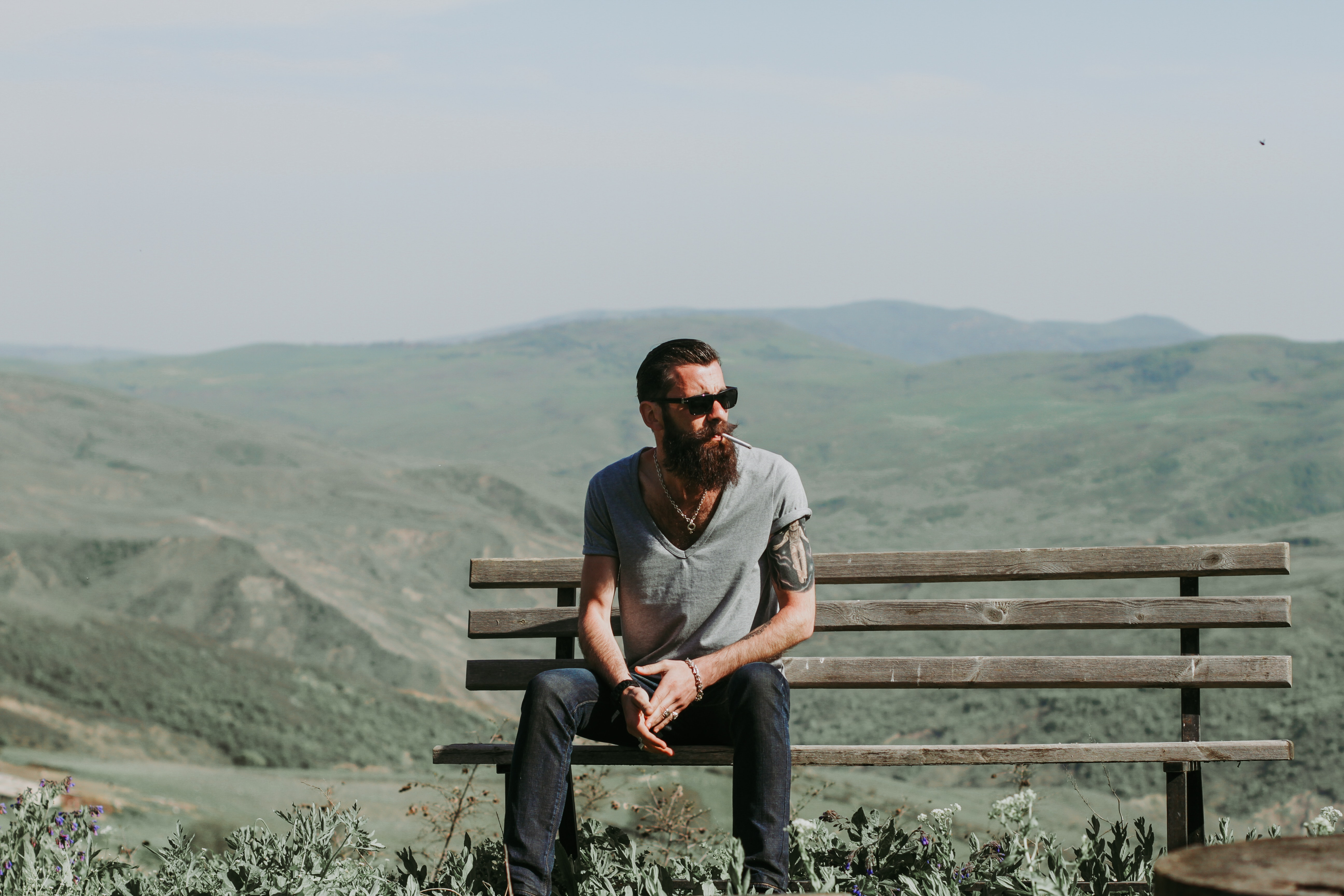 Photography of a man sitting on wooden bench