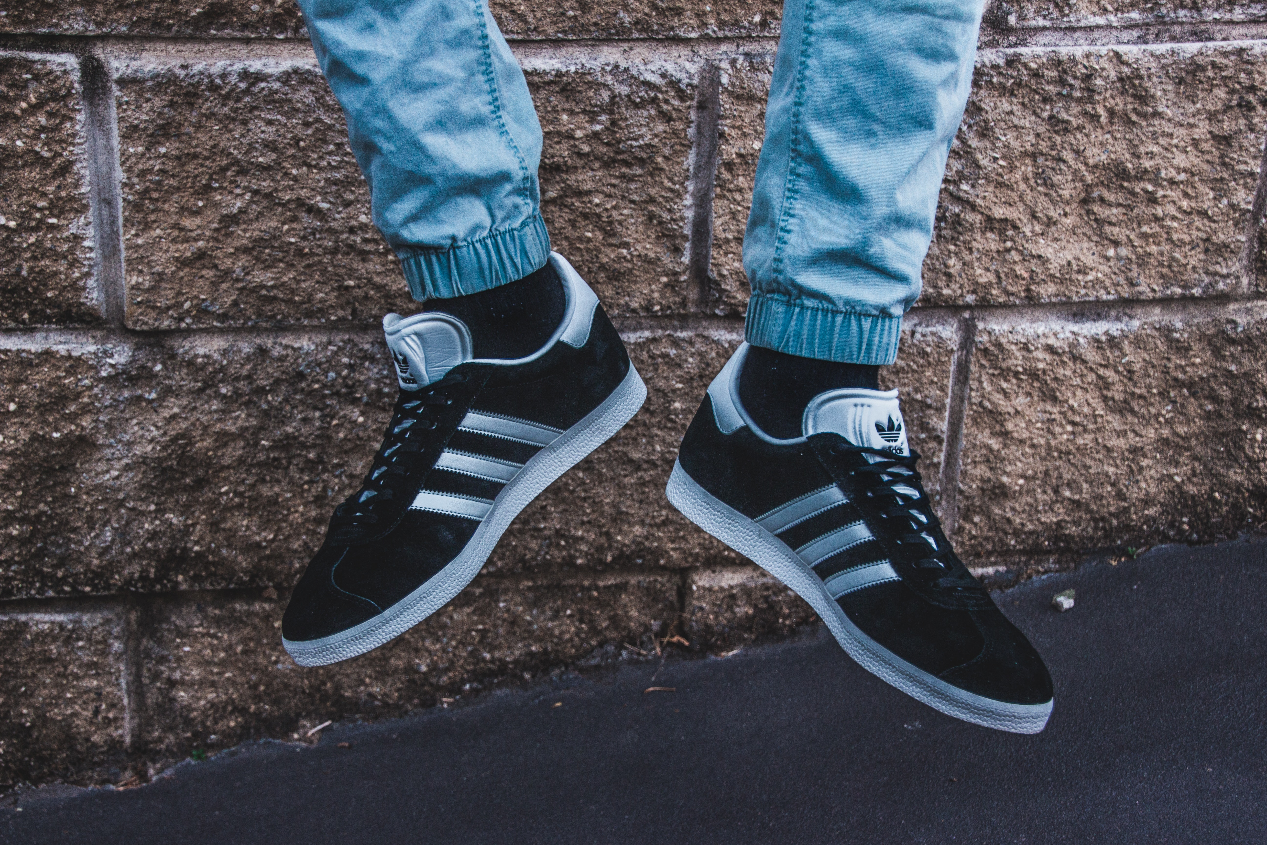 Photography of a Person Wearing Adidas