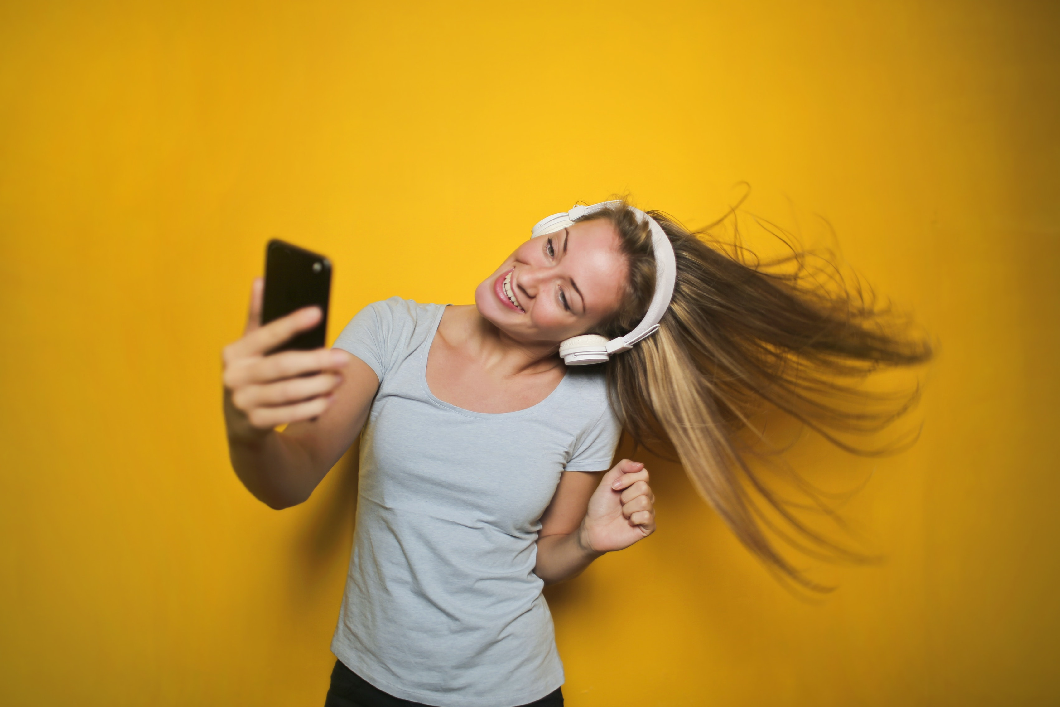 Photography of a woman listening to music