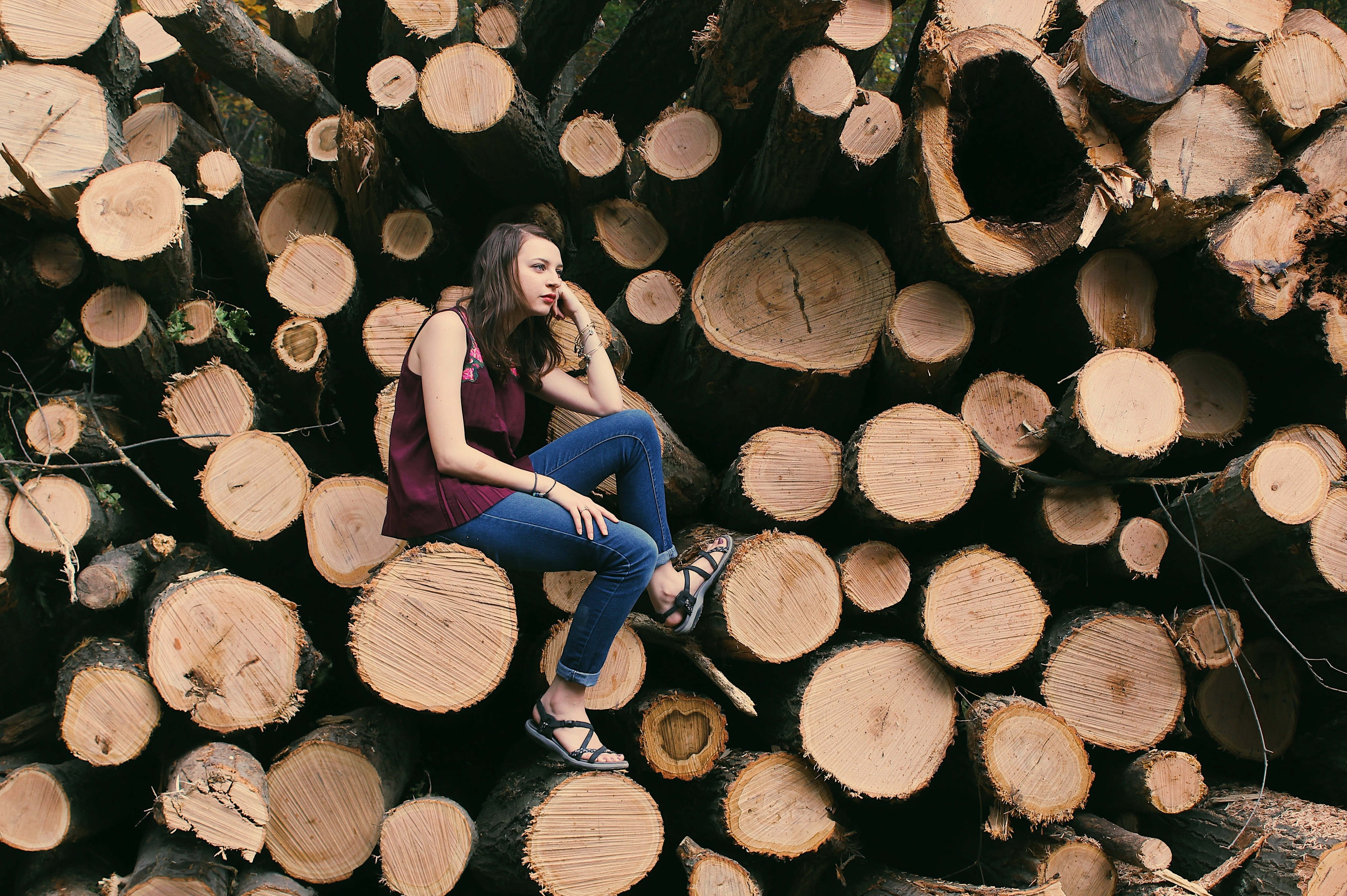 Photography of a woman sitting on a log