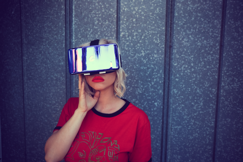 Photography of a woman wearing virtual reality headset