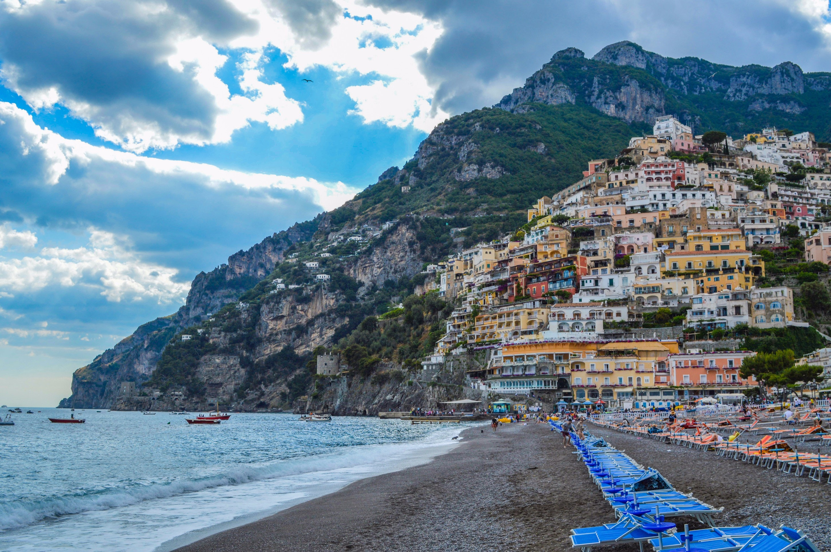 Photography of beach near mountain