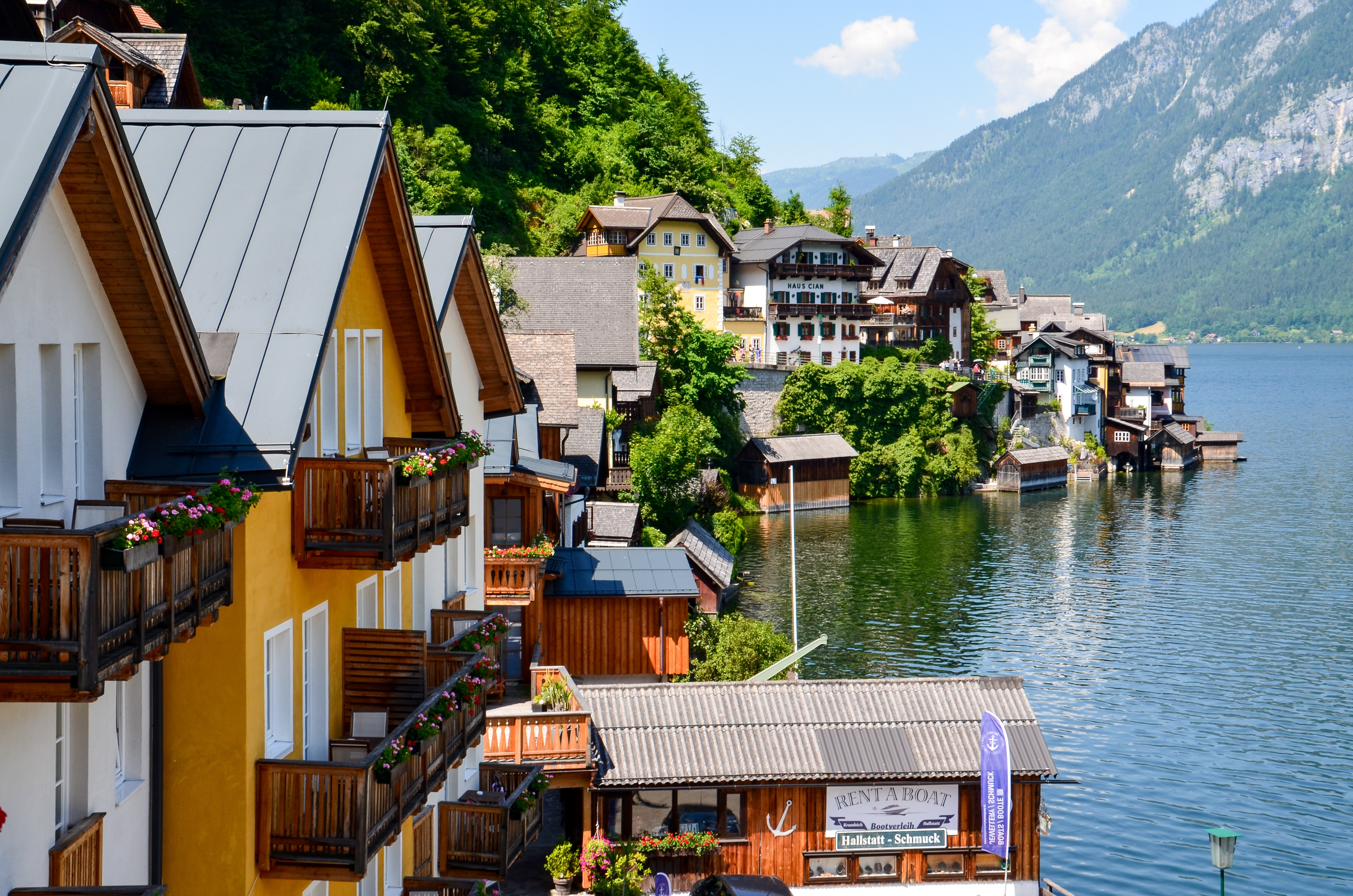 Photography of houses beside body of water