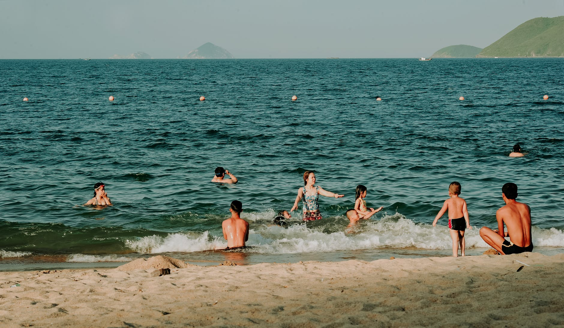 Photography of people swimming in the sea