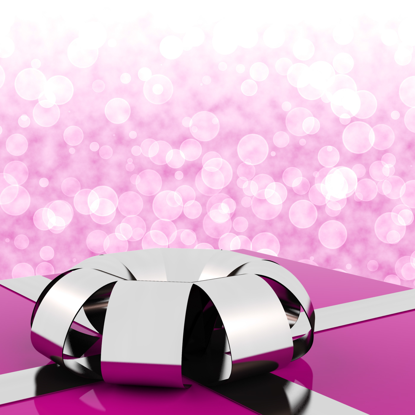 Pink giftbox with bokeh background for womens birthday photo