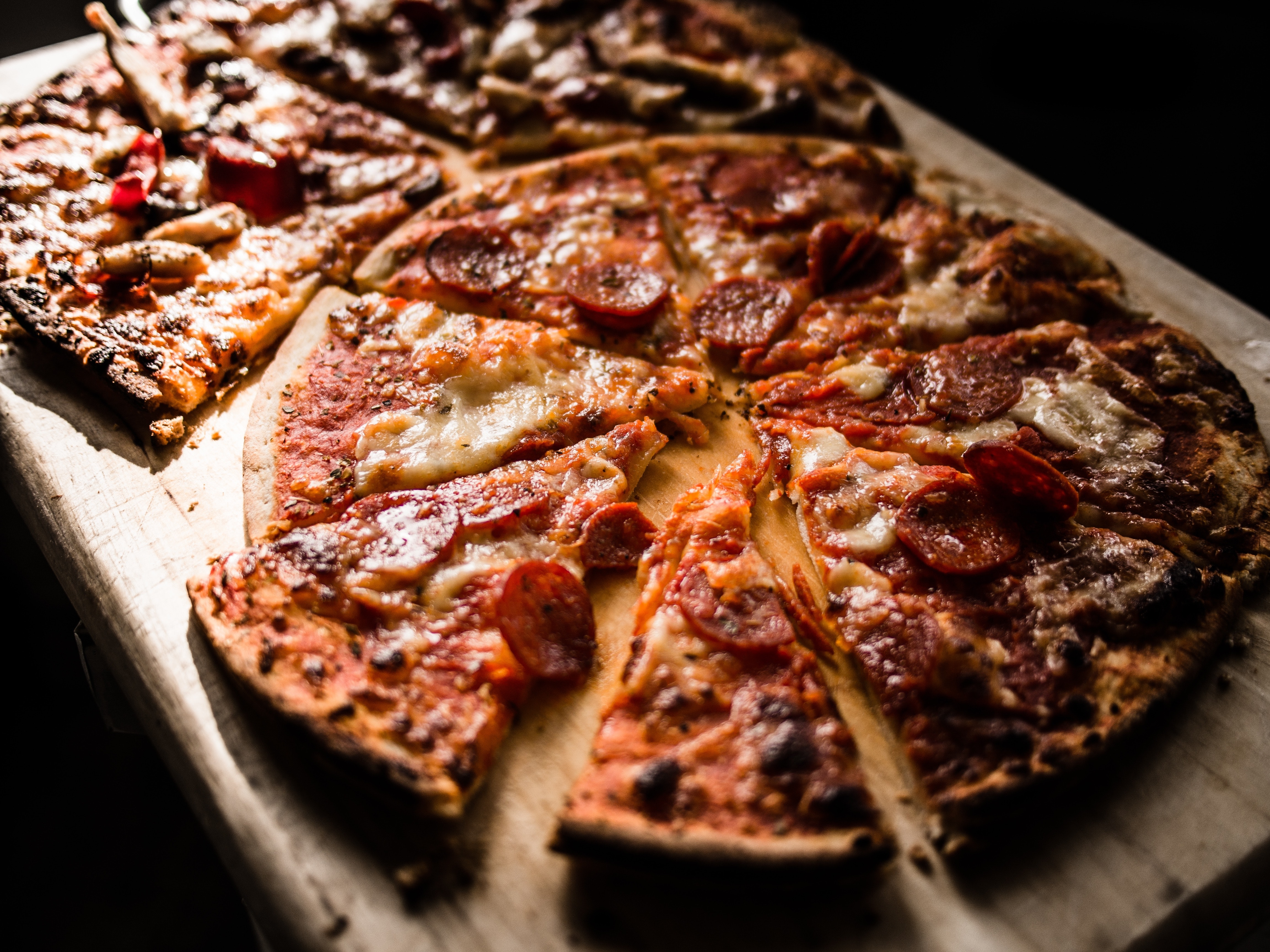 Pizza on brown wooden board photo
