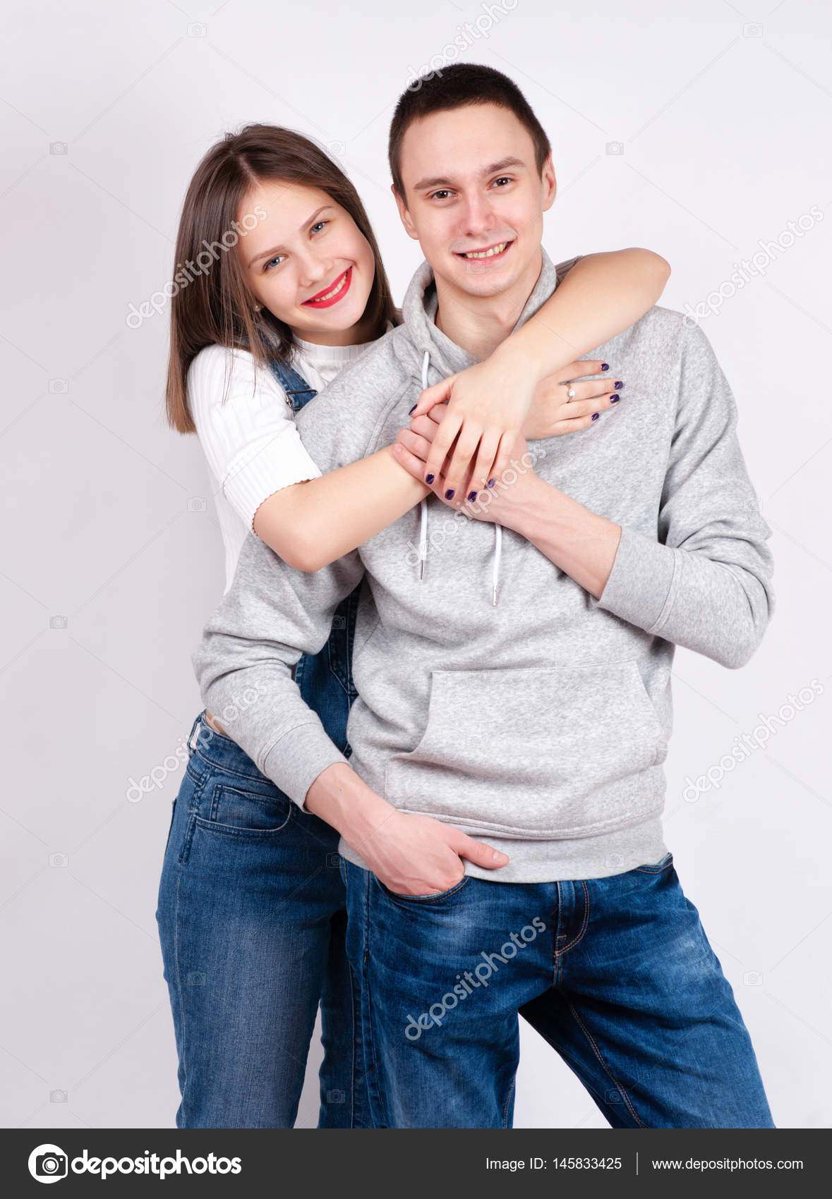 Playful couple hugging photo