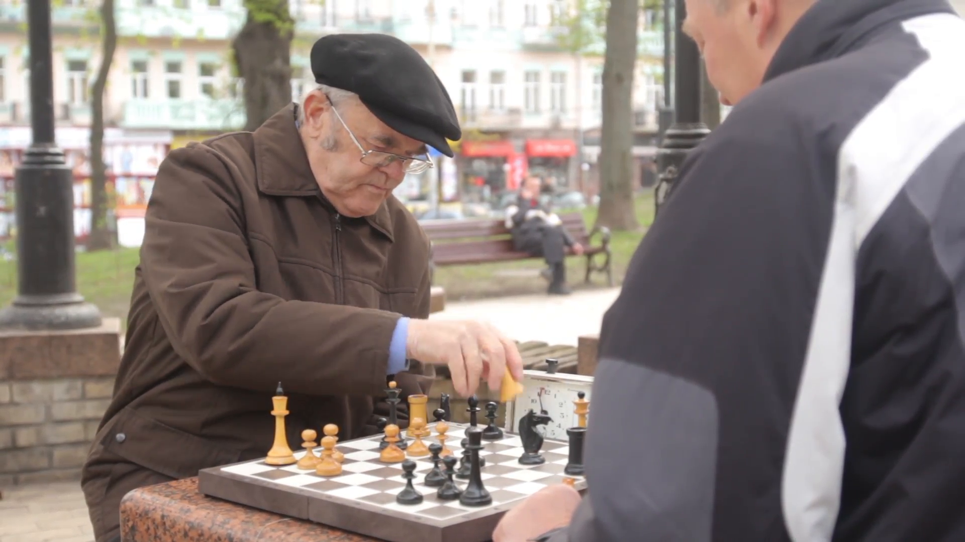 Old man in hat playing chess on the street Stock Video Footage ...