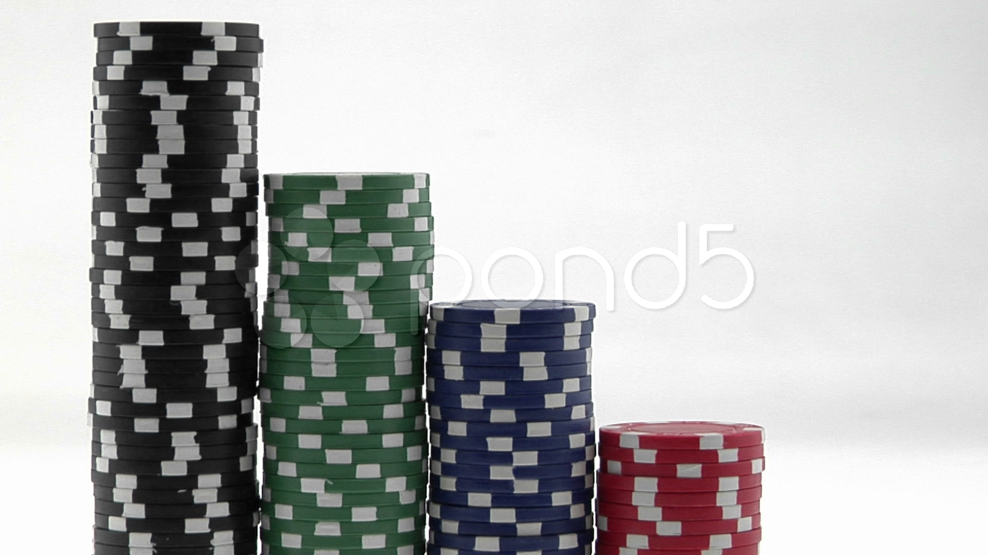 Video: Stacks of poker chips sit in a row, arranged by value. ~ #557619