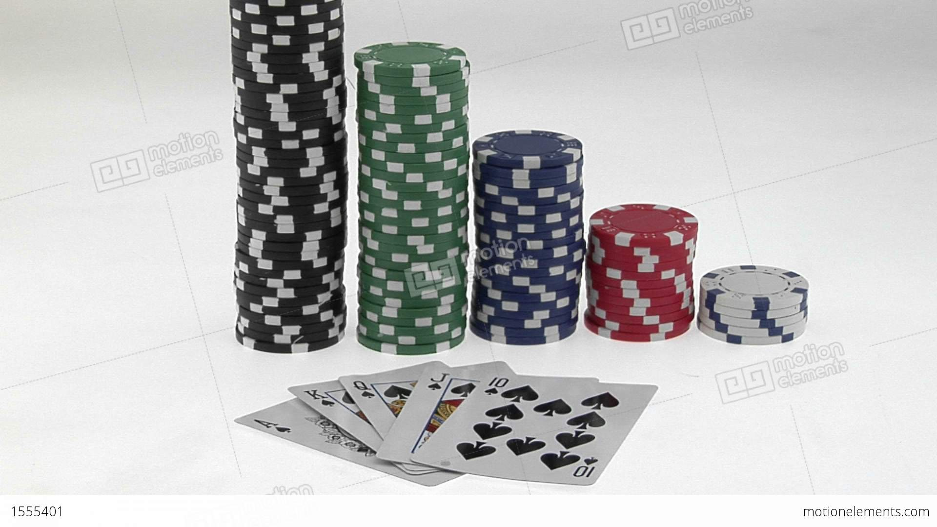 Stacks Of Poker Chips Sit In A Row, Arranged By Value Behind A Deck ...
