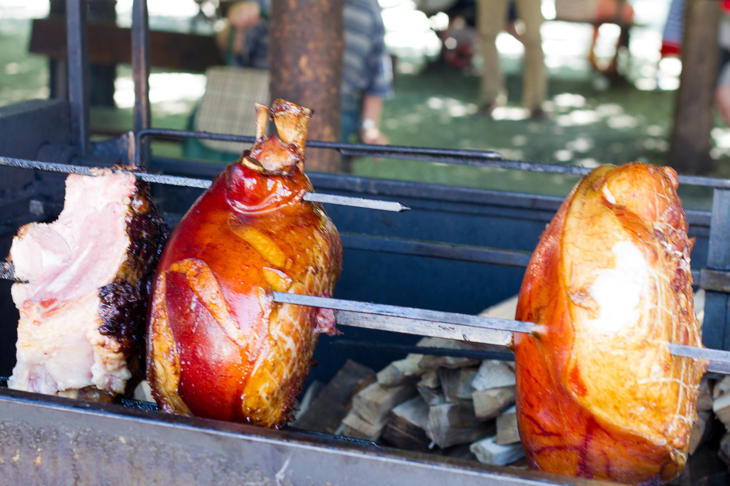 Pork roasting over fire photo