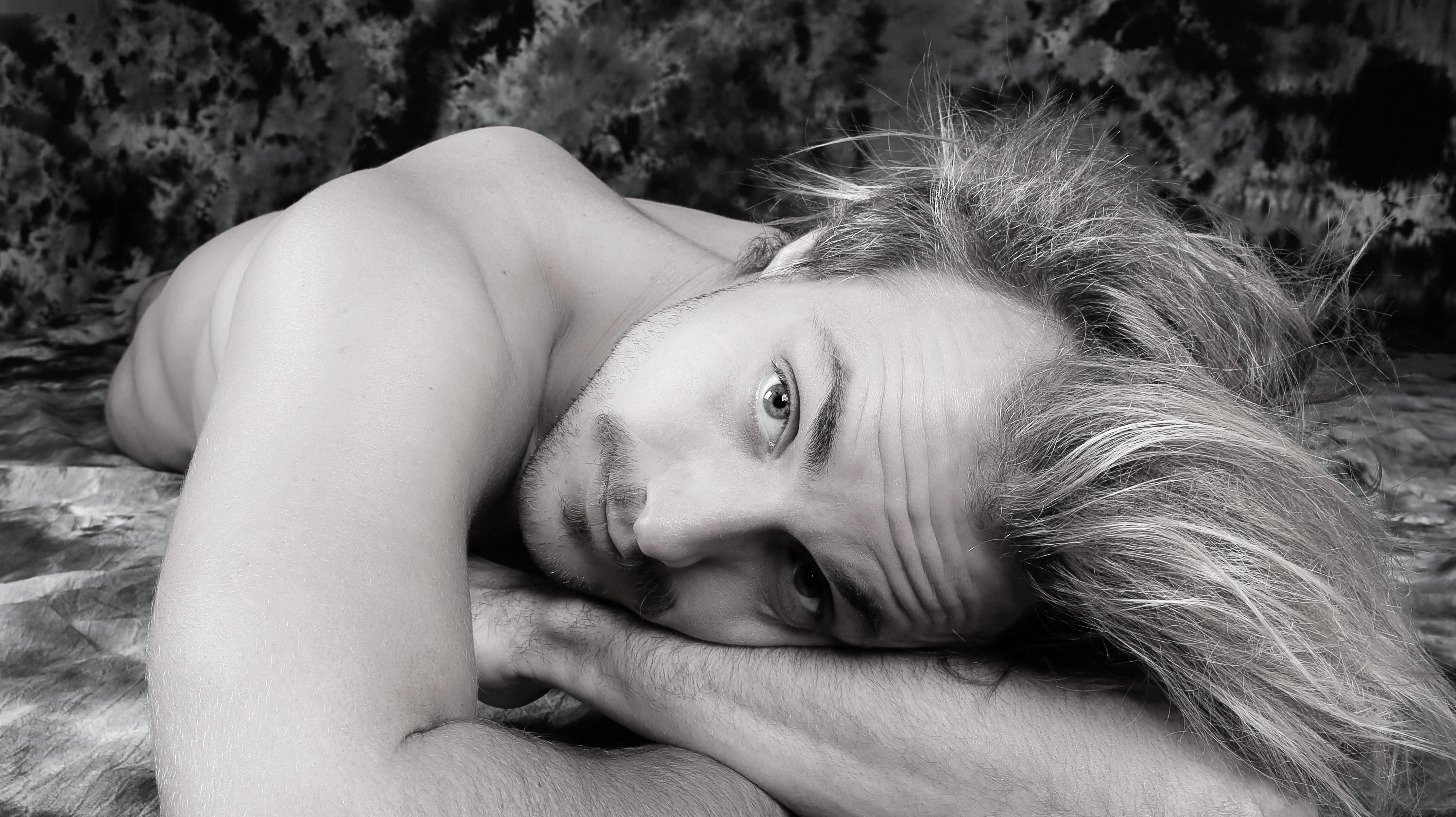Portrait of man lying down photo