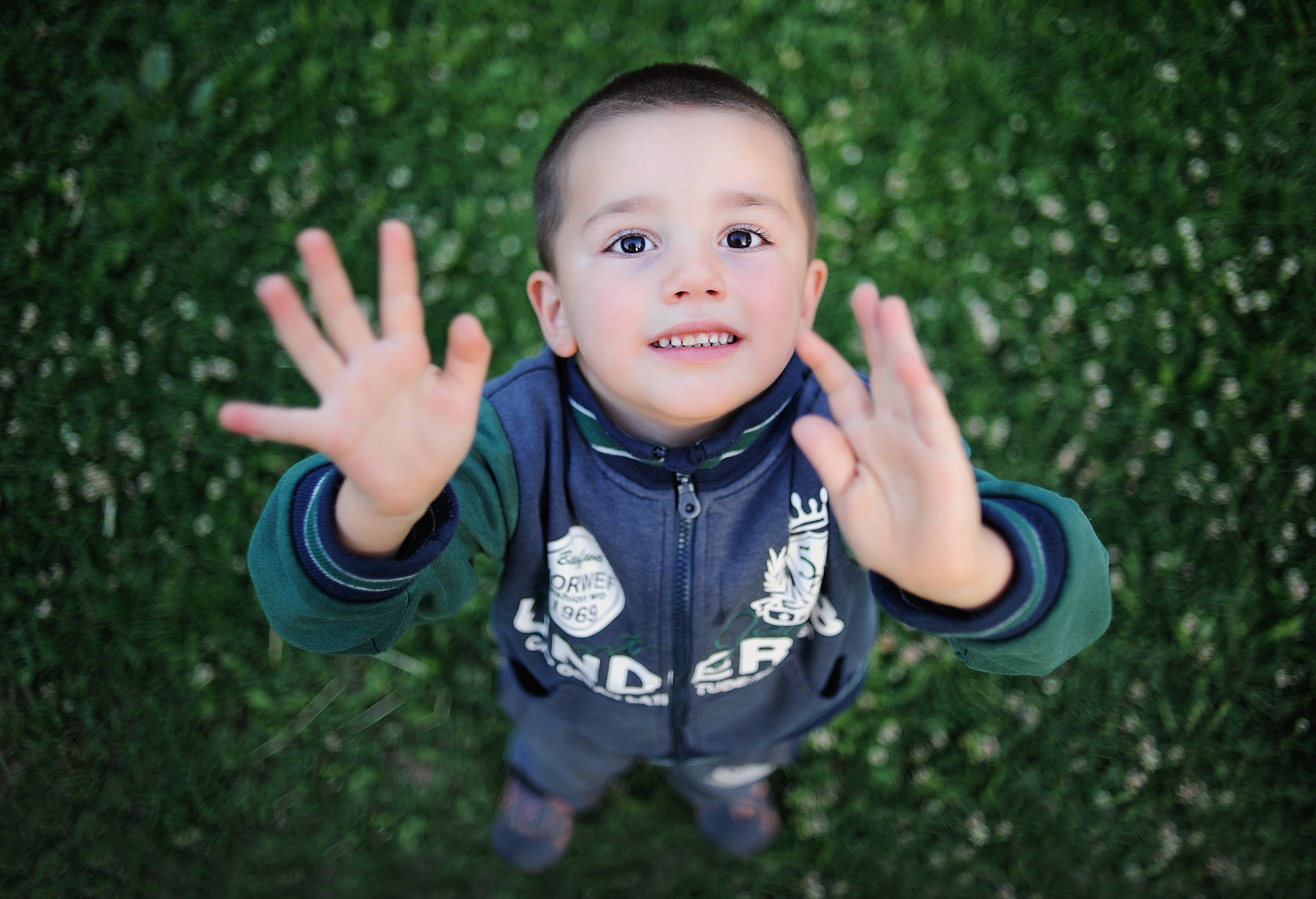 Portrait of smiling boy with arms outstretched photo