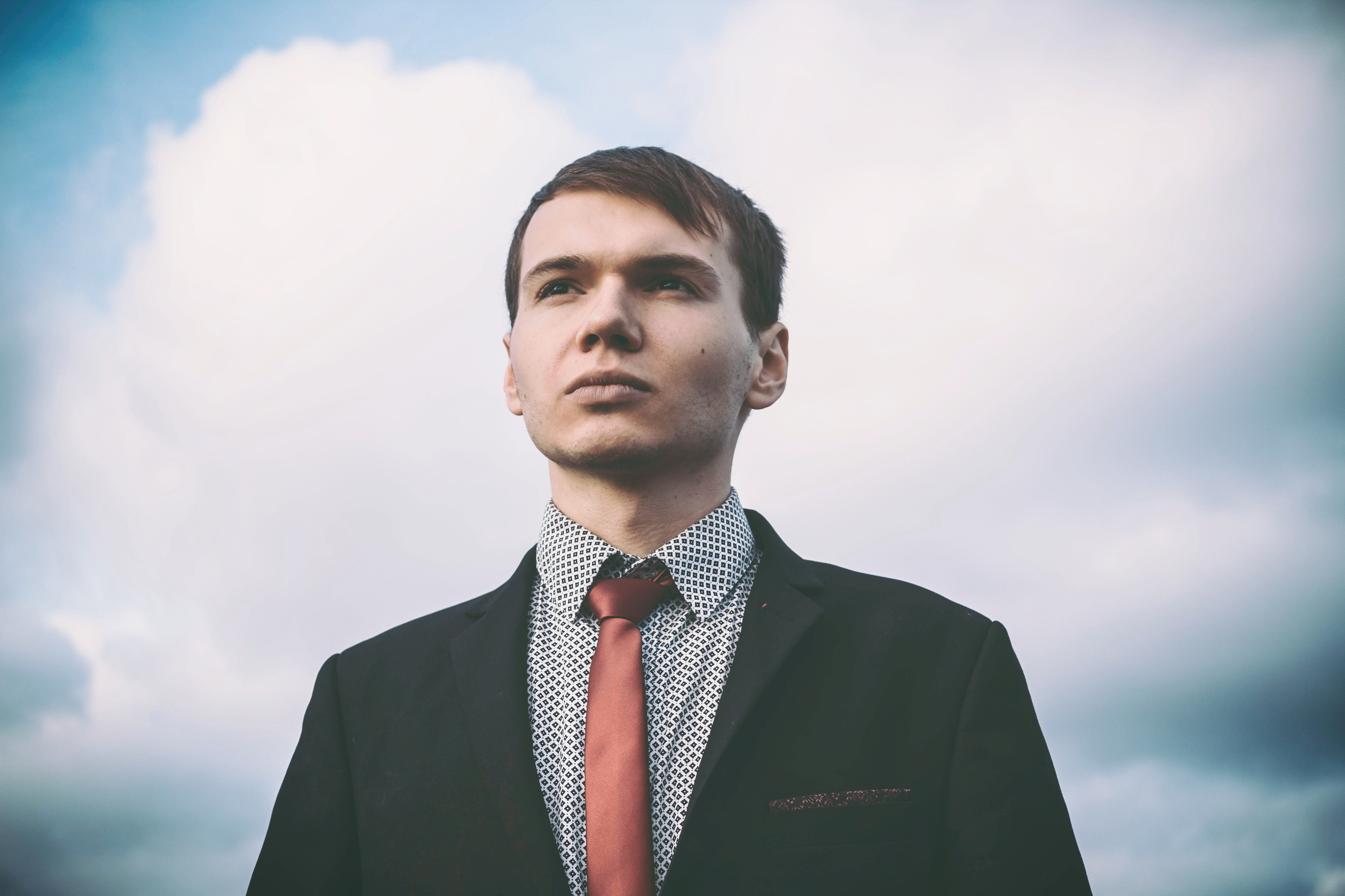 Portrait of young man against sky photo