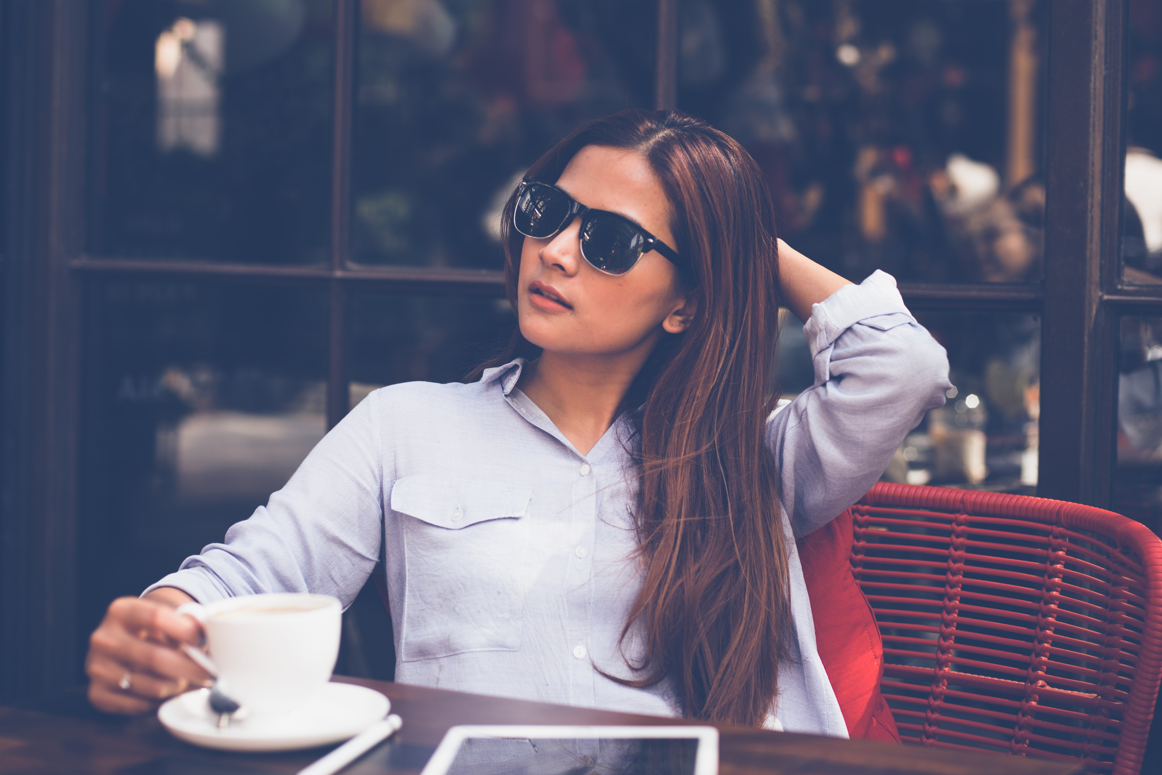 Portrait of young woman drinking coffee at home photo