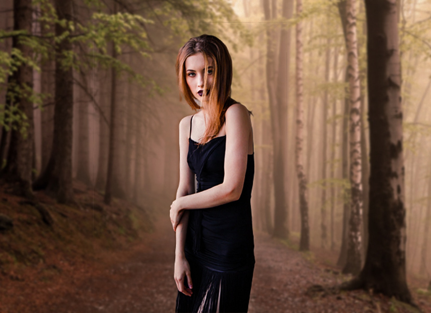Portrait of young woman in forest photo