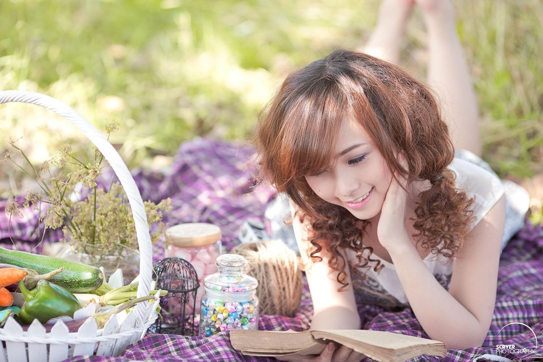 Pretty girl reading book photo