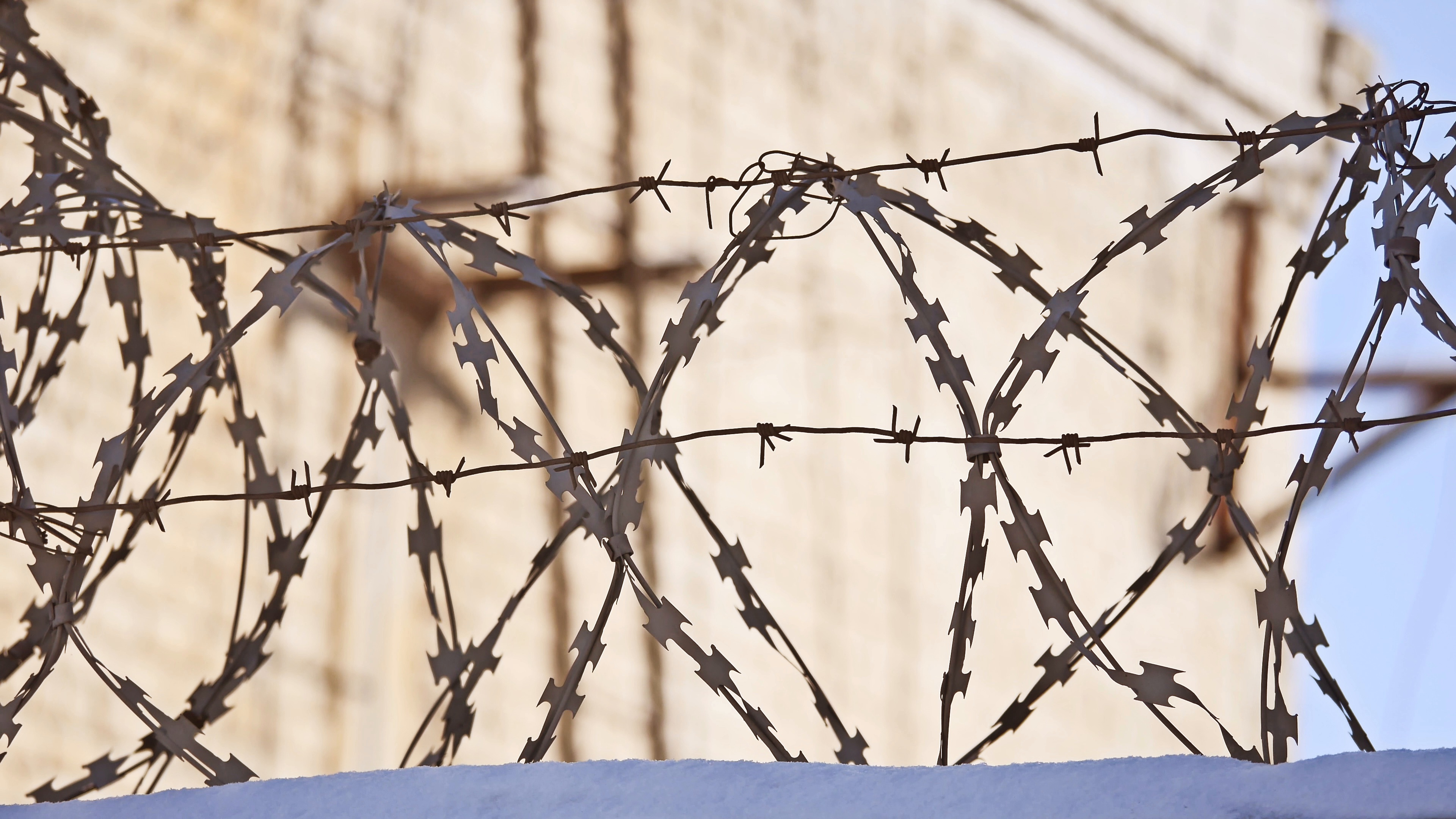 Video: Barbed wire fence at the prison, the sun glare on a ...
