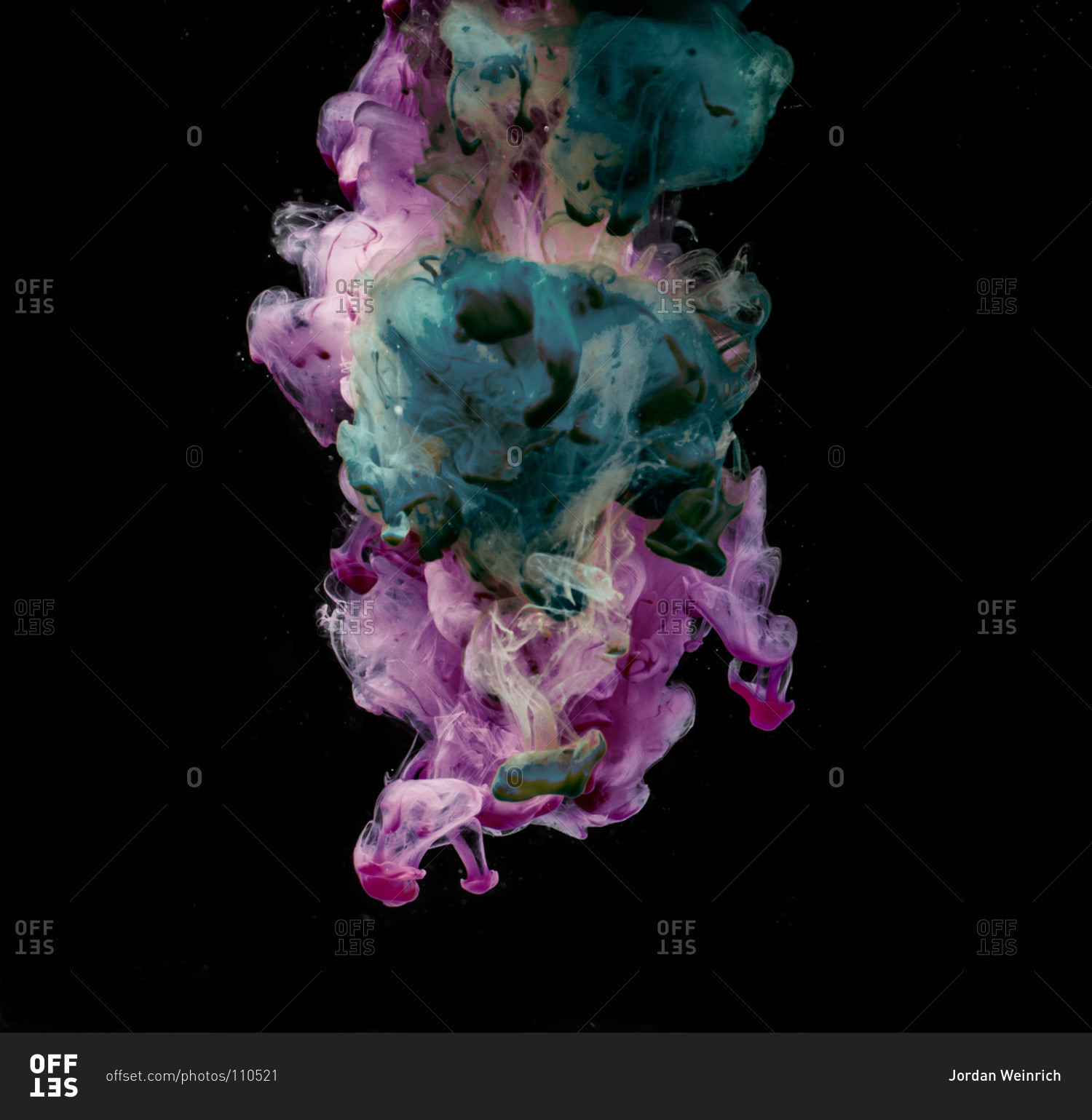 Green and purple smoke come together on a black background. stock ...