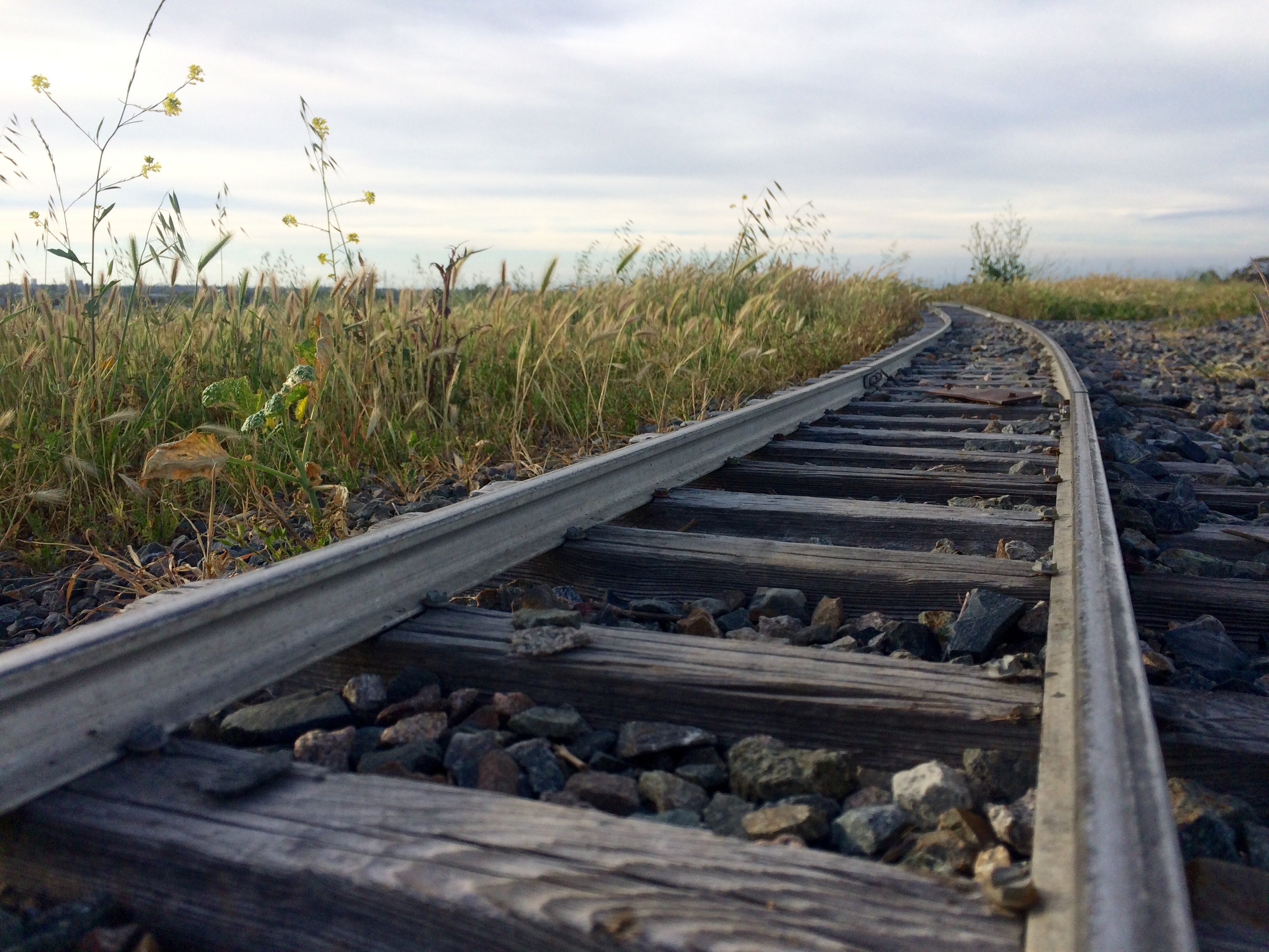 Railroad track against sky photo