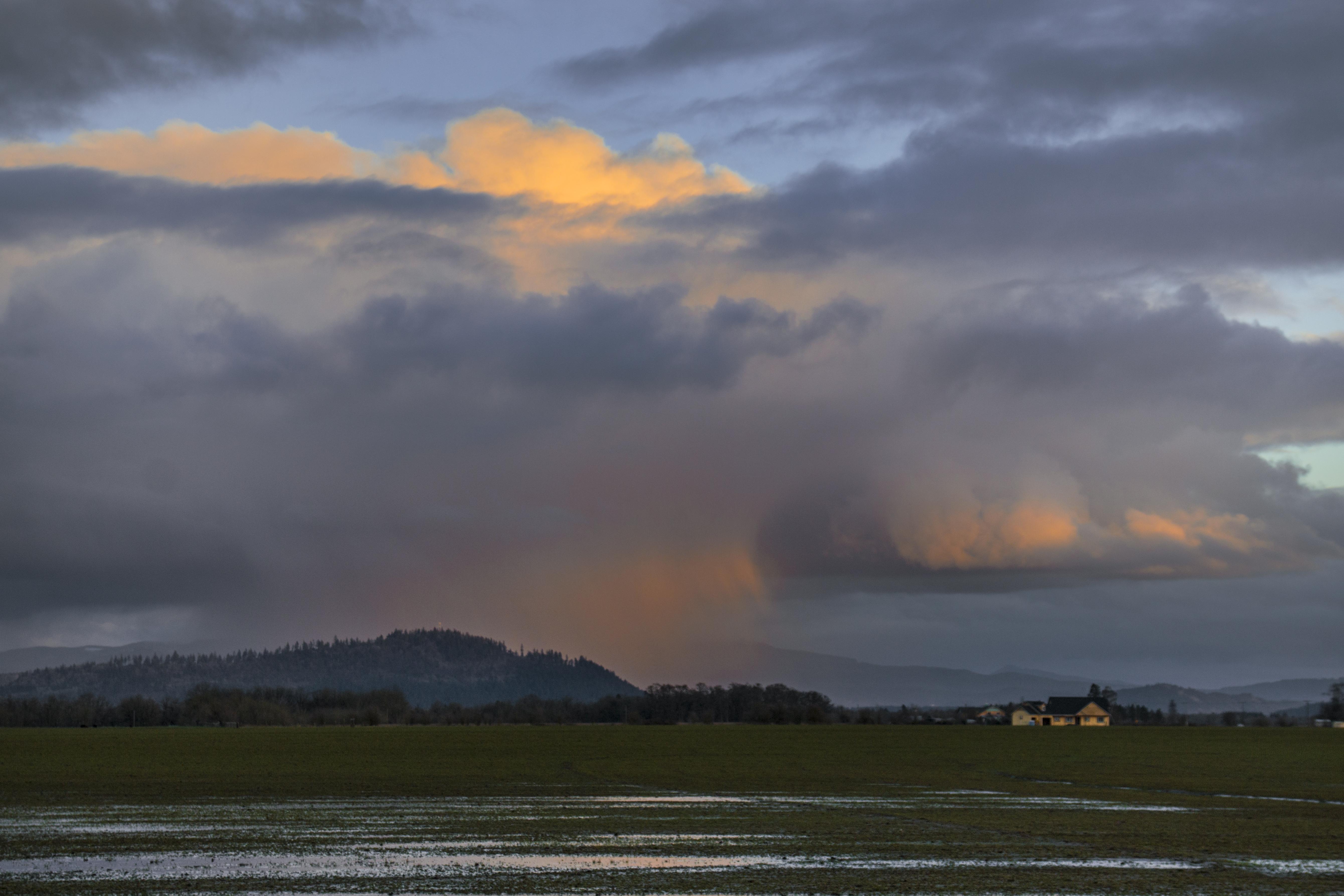 Rain clouds over willamette valley farm, oregon photo