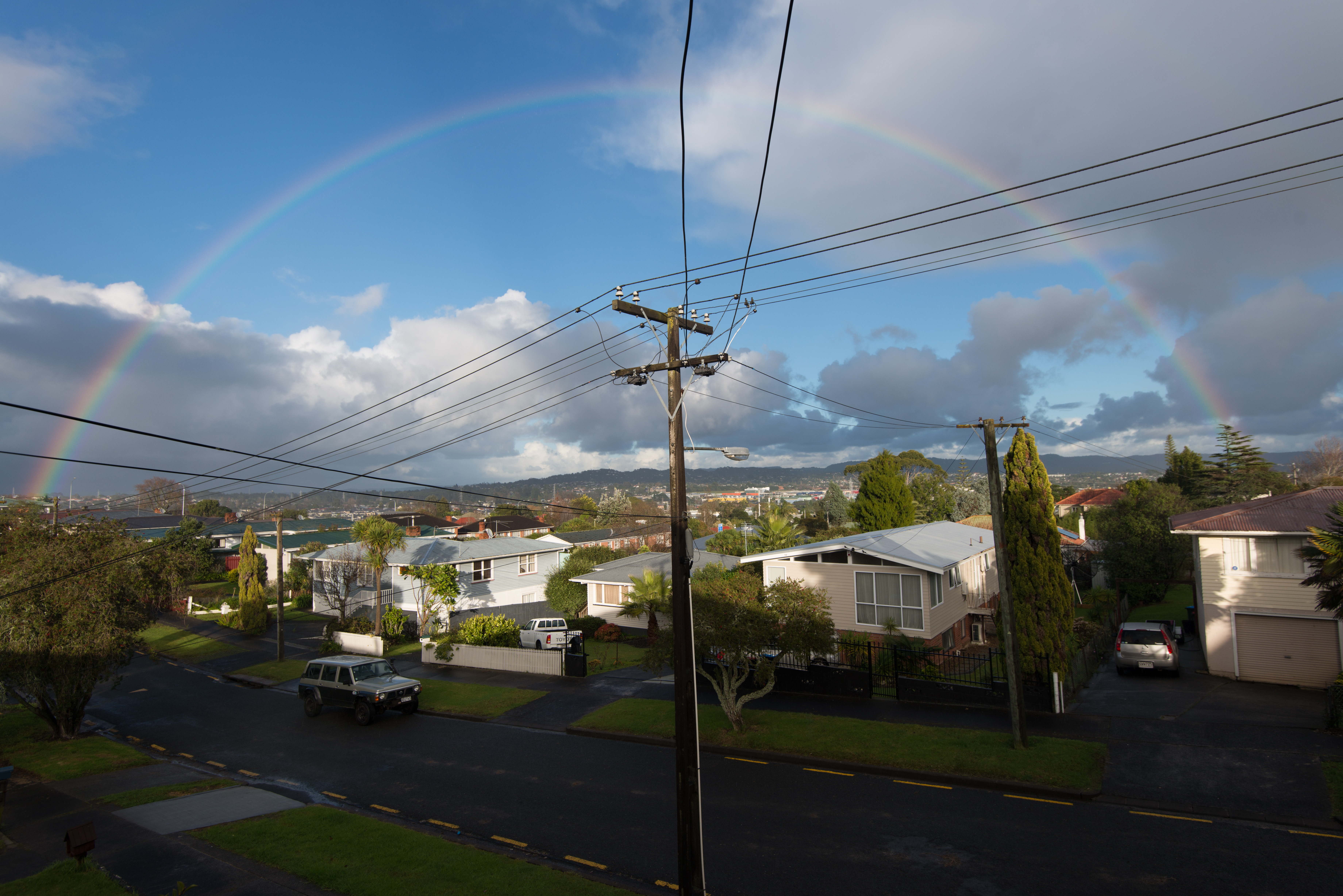 Rainbow in residential neighborhood in Avondale, Auckland, Vehicle, Power line, Outdoor, Cable, HQ Photo