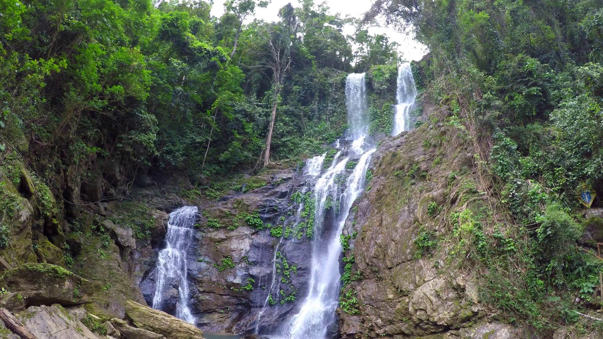 High waterfall in the rainforest on the island of Mindoro in ...