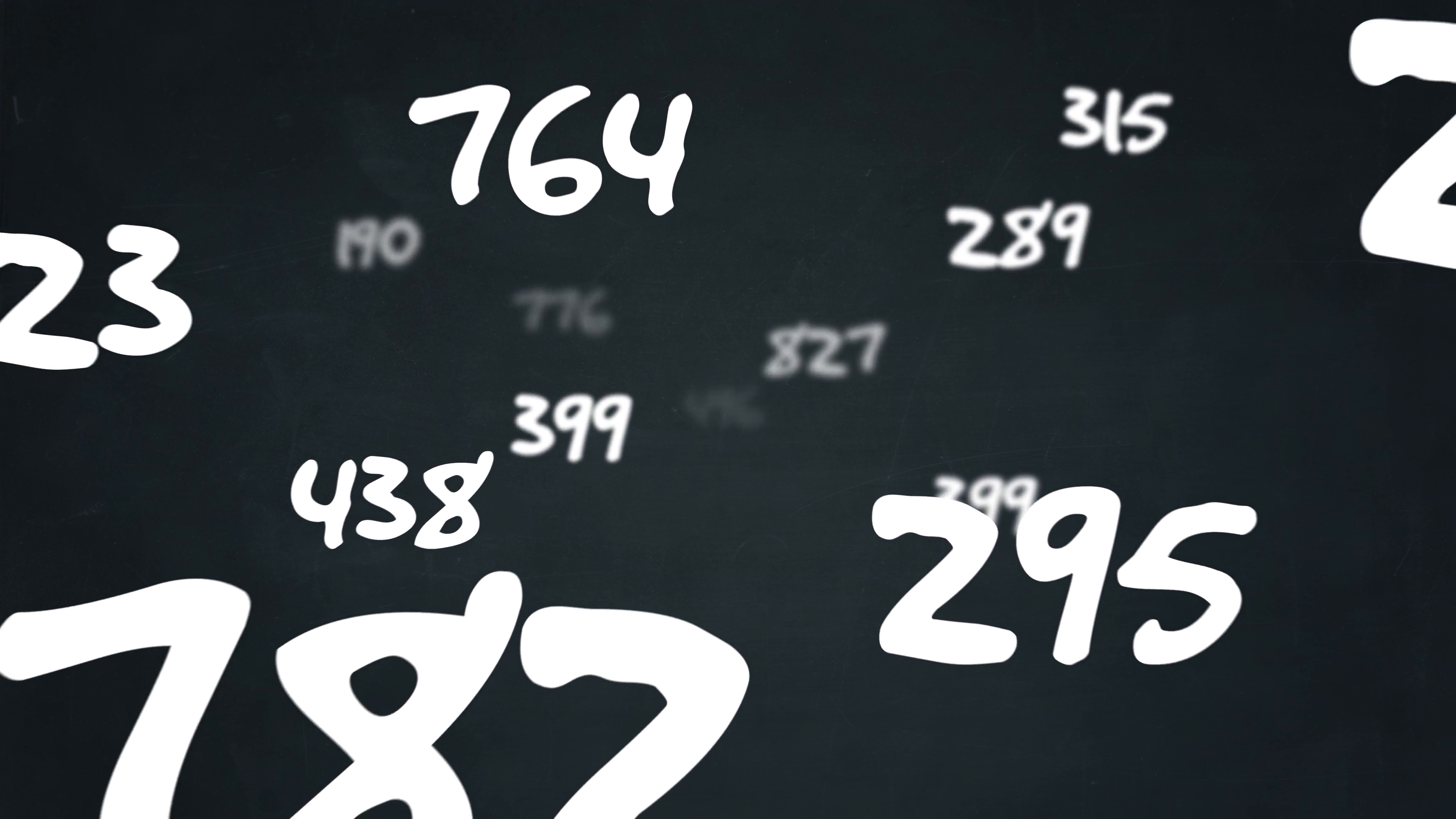 Various random numbers floating by on a chalkboard background ...