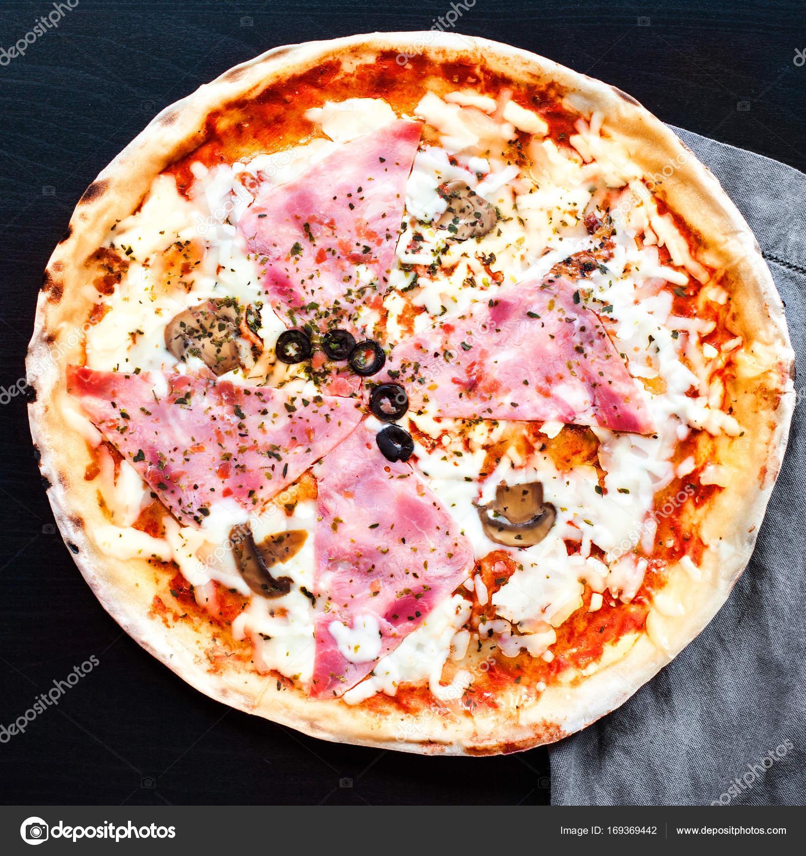 Delicious raw italian pizza — Stock Photo © Zakharova #169369442