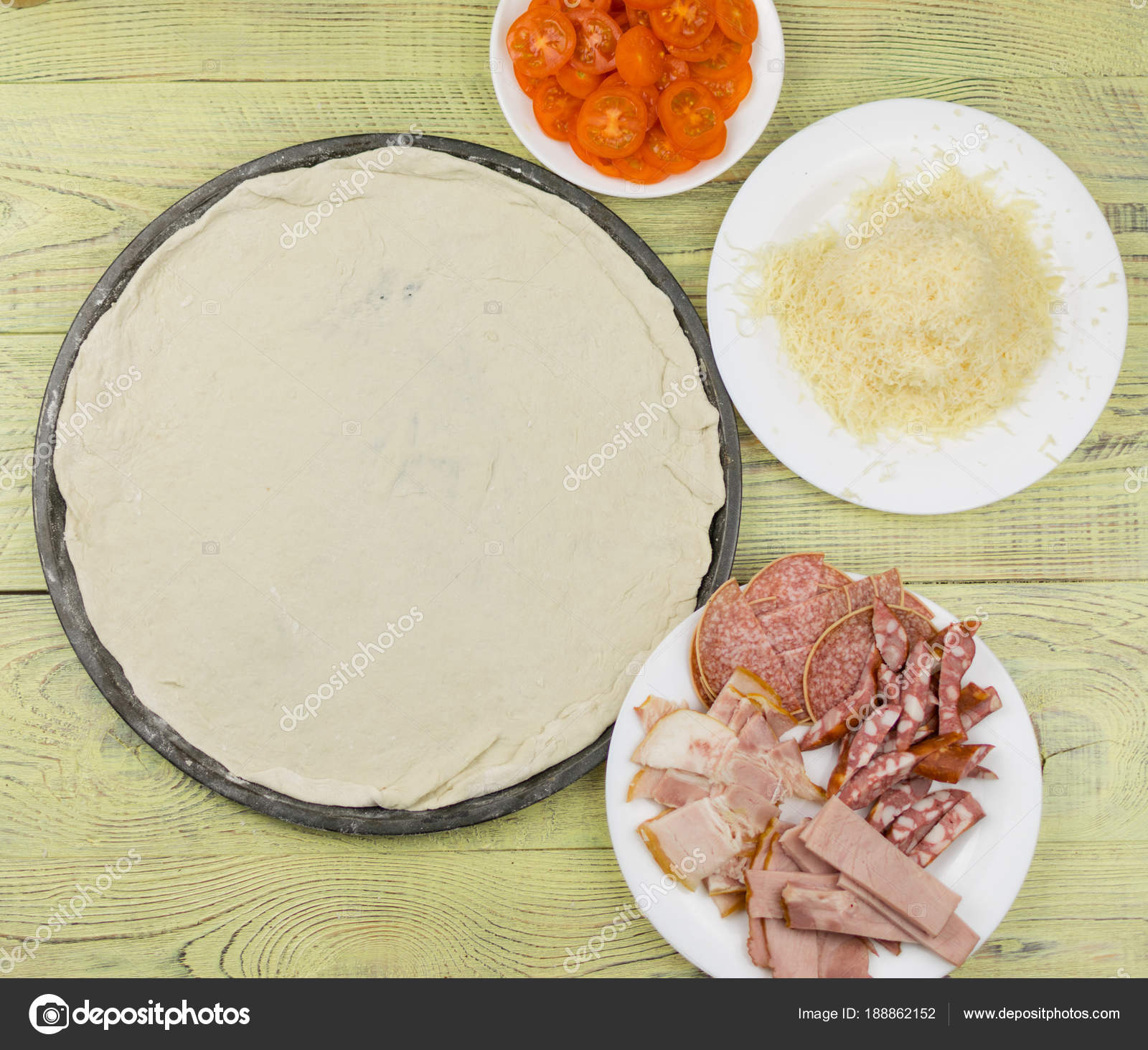 Fresh raw Italian pizza during cooking. Ingredients for pizza ...