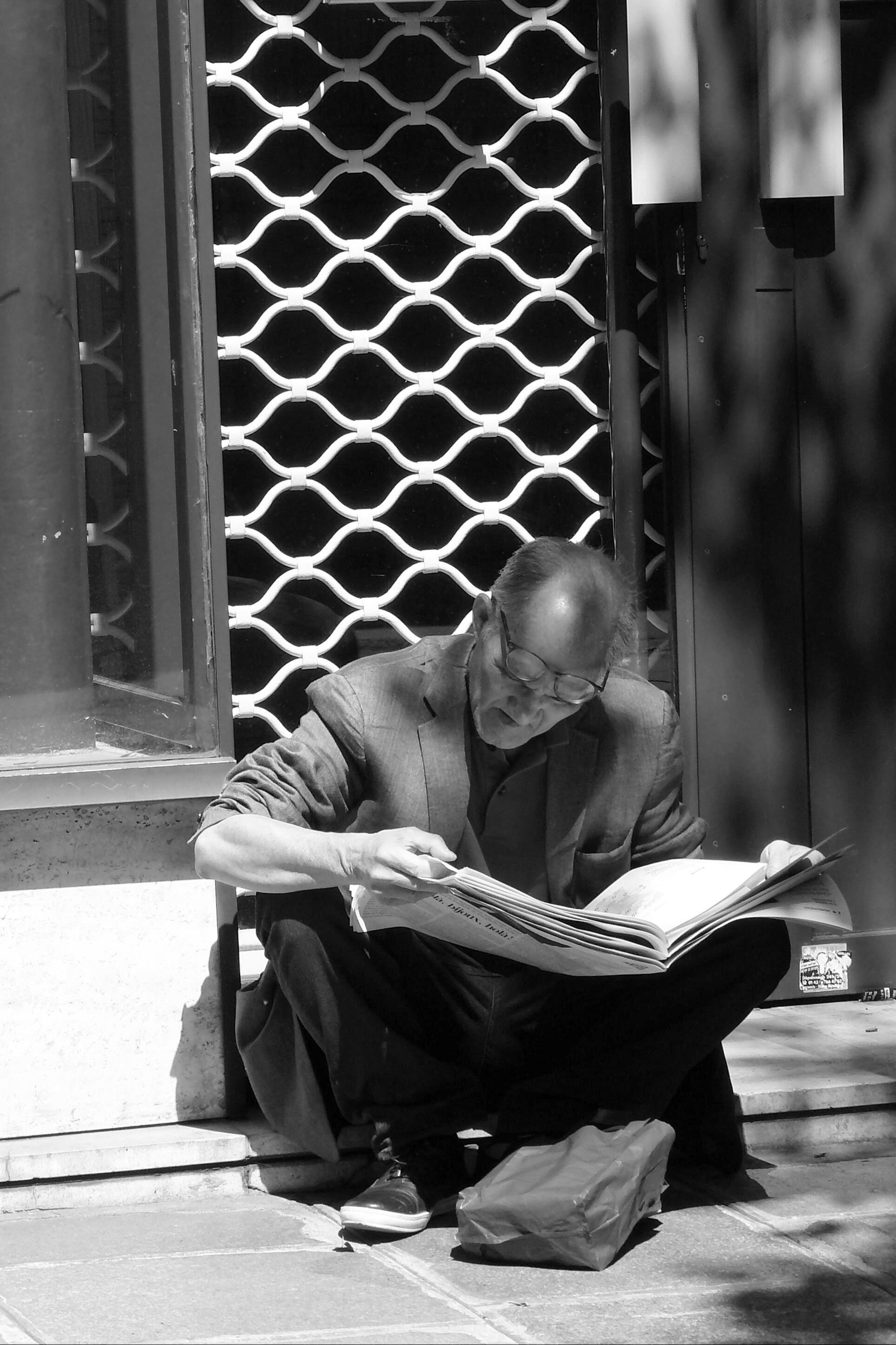 Reading newspaper photo