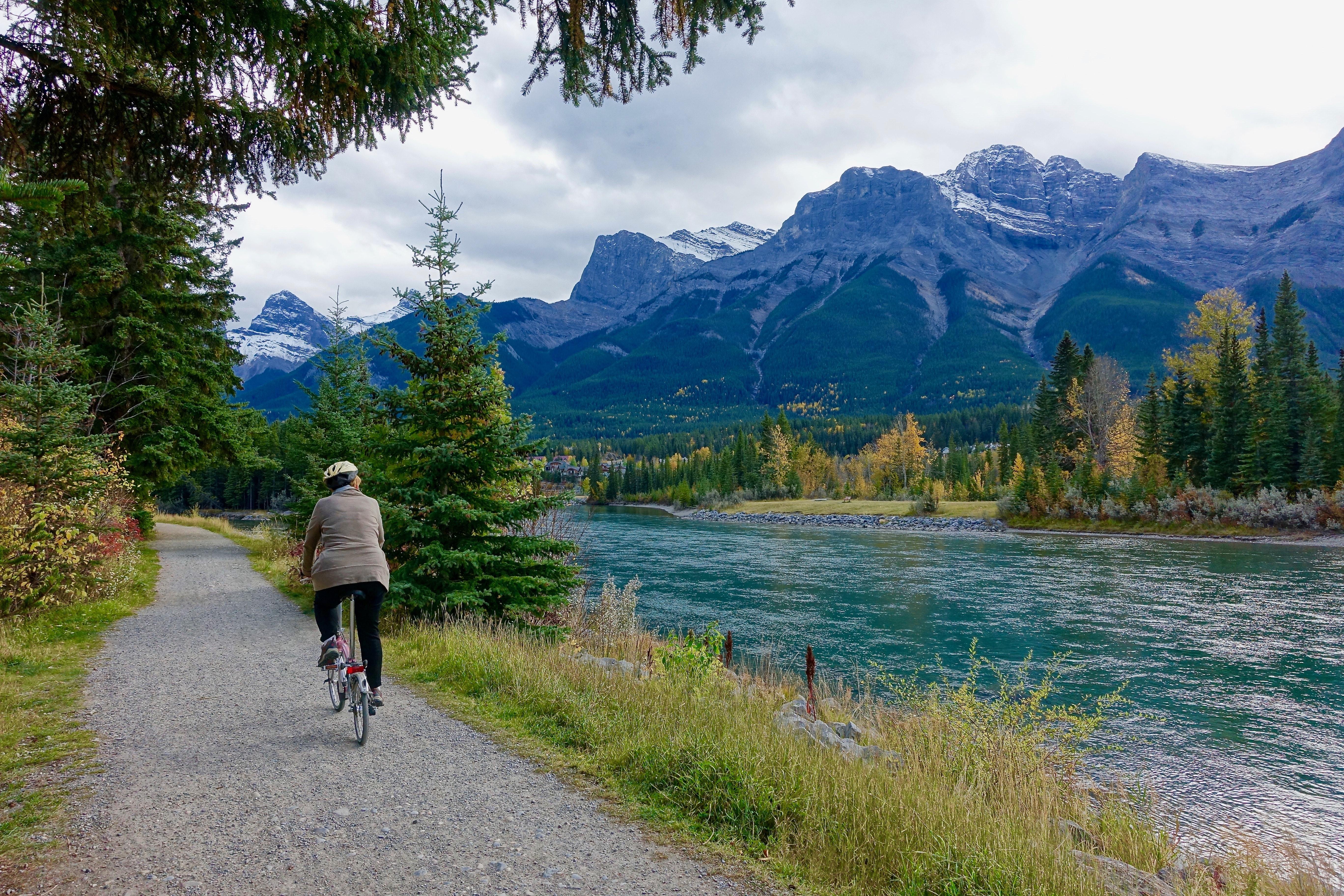 Rear view of woman walking on mountain road photo