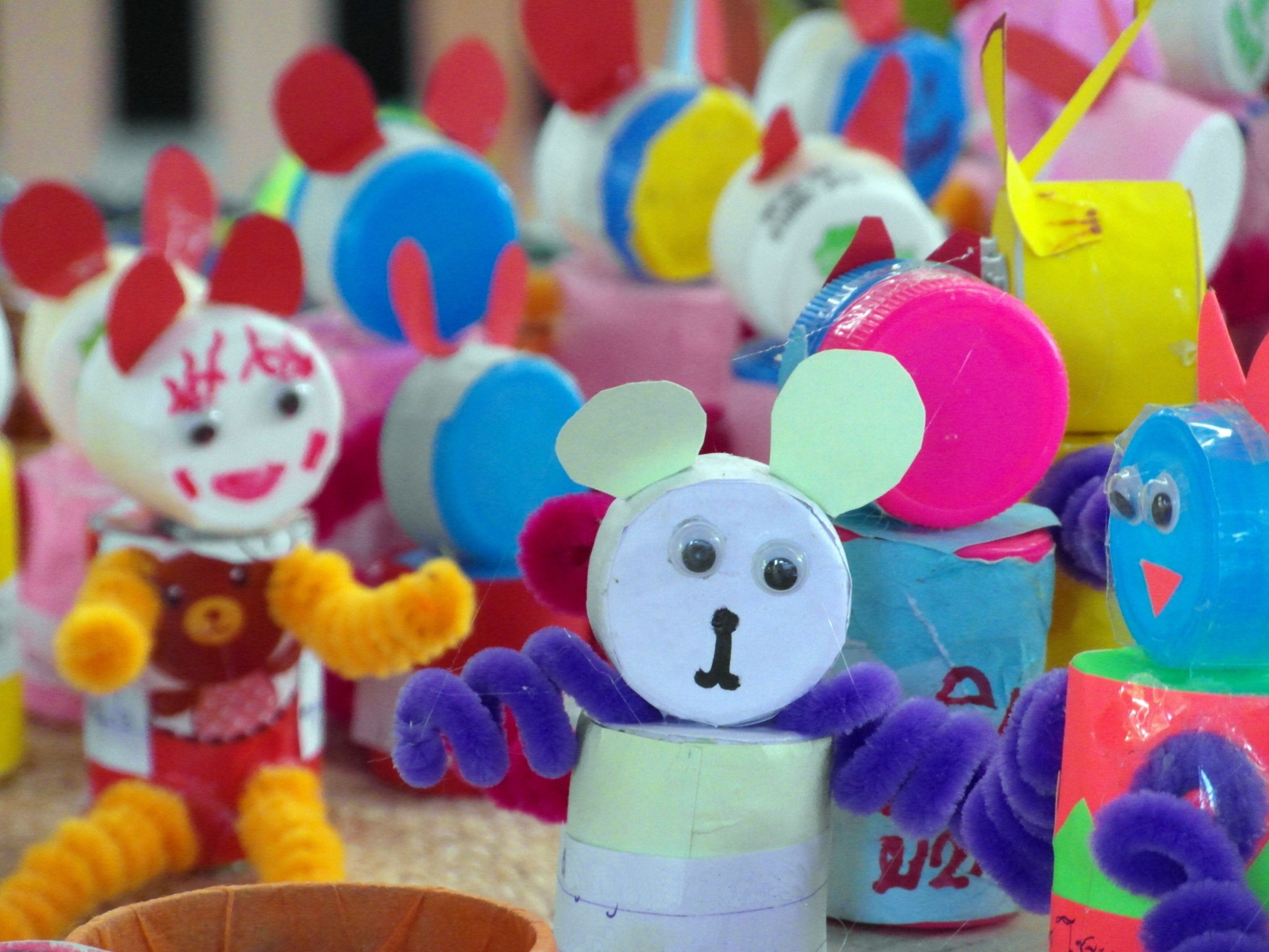 Recycled bottle tops craft dolls photo