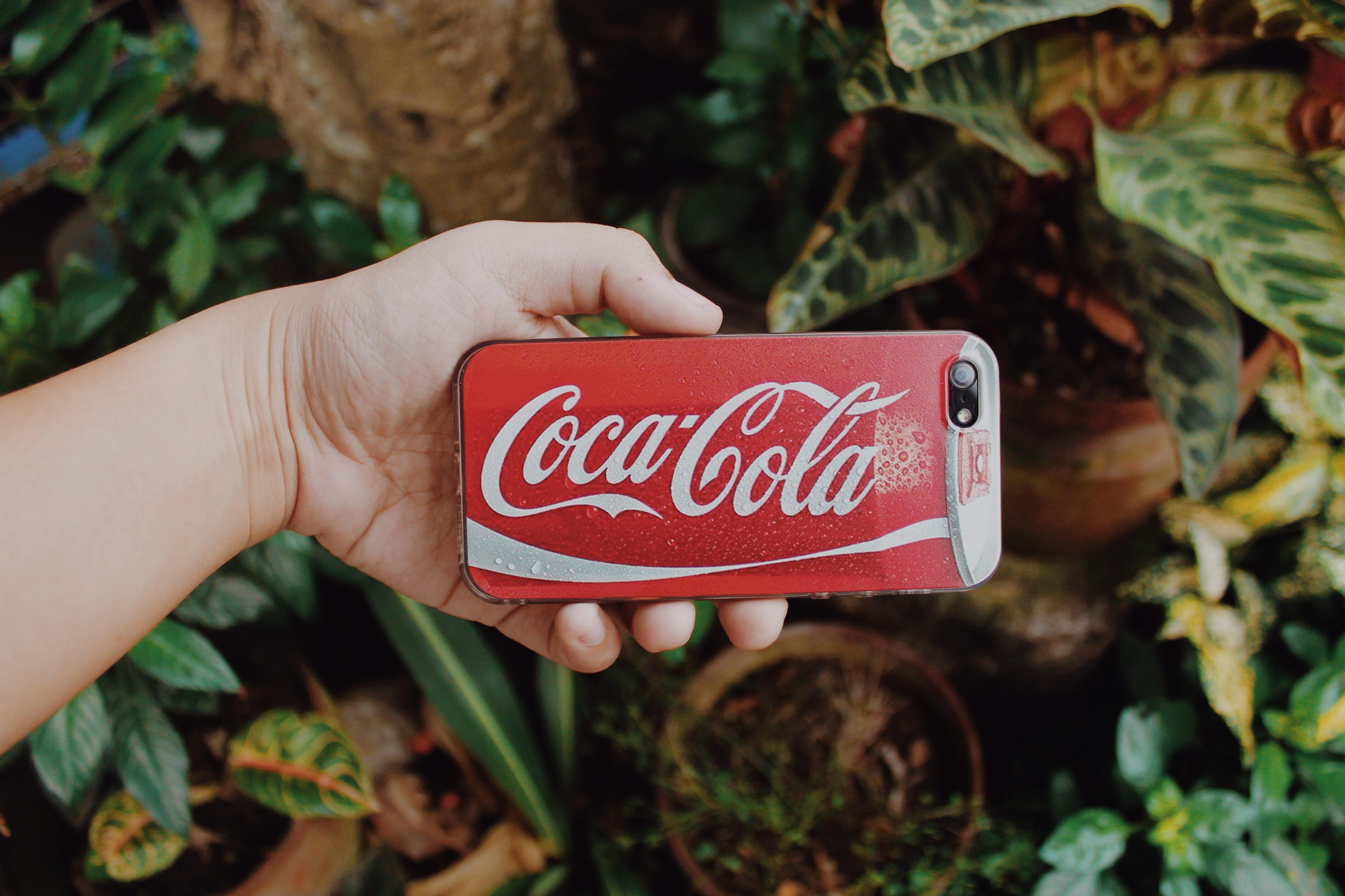 Red and white coca-cola smartphone case photo