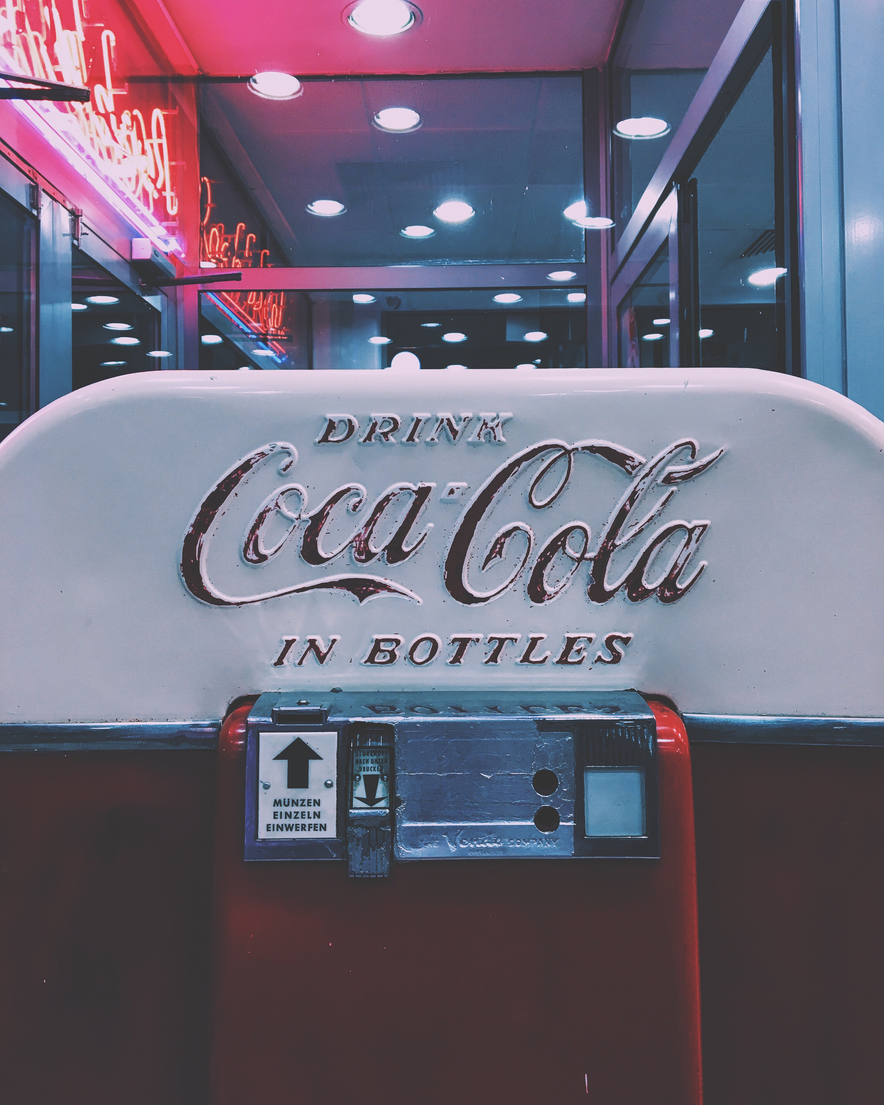 Red and white drink coca-cola in bottle dispenser photo