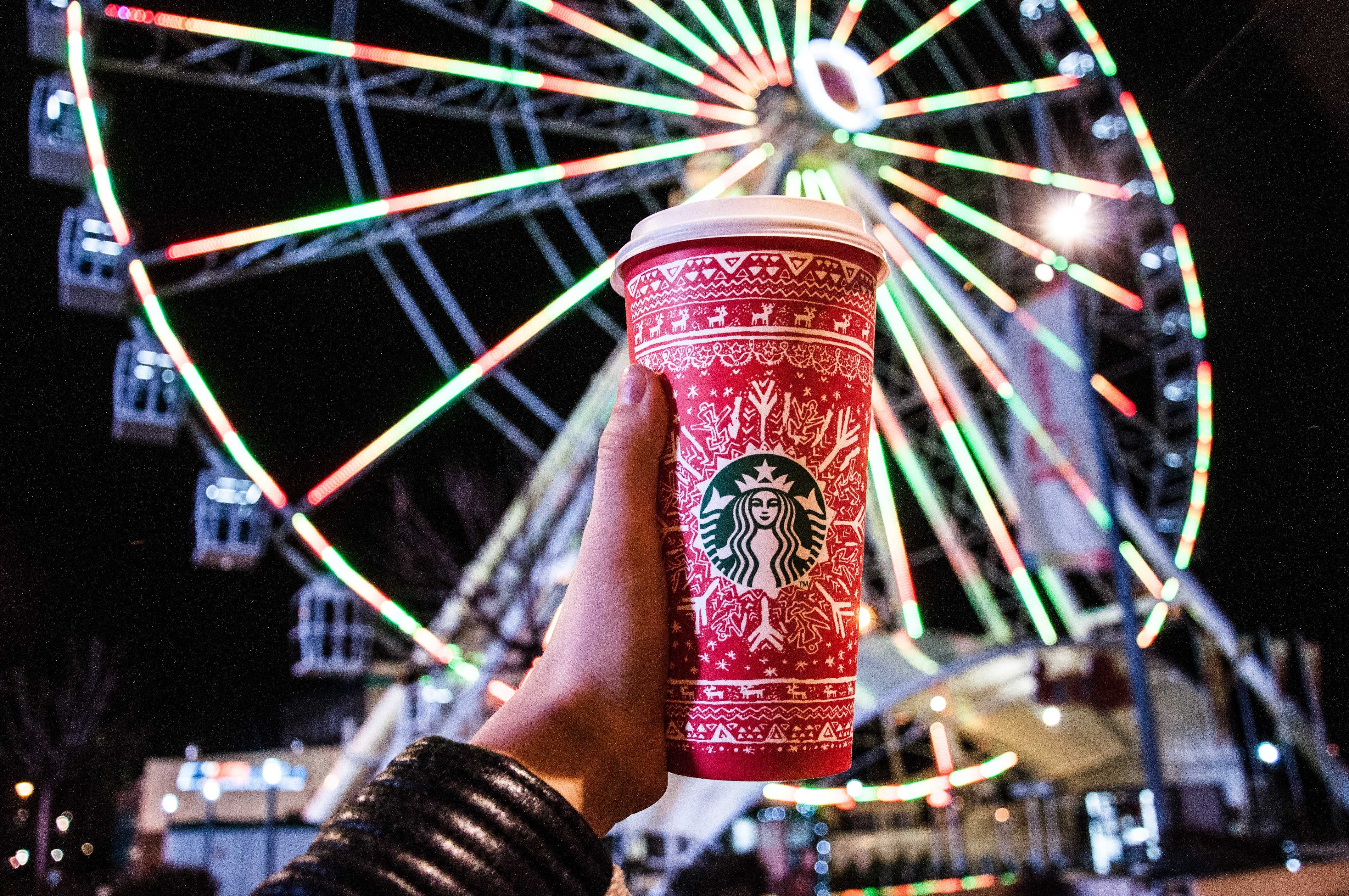 Red and white starbucks disposable cup photo