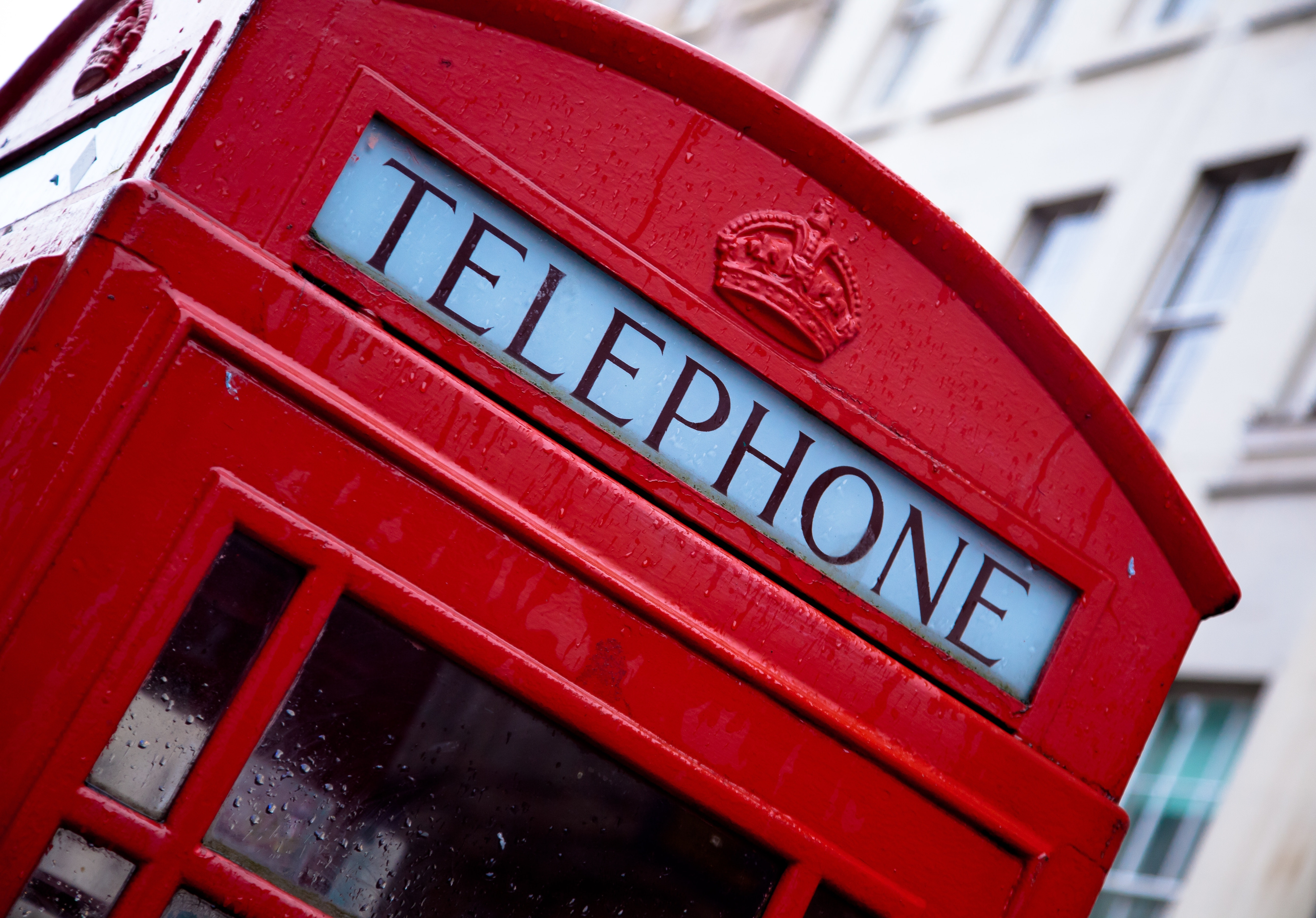 Red and white telephone booth photo