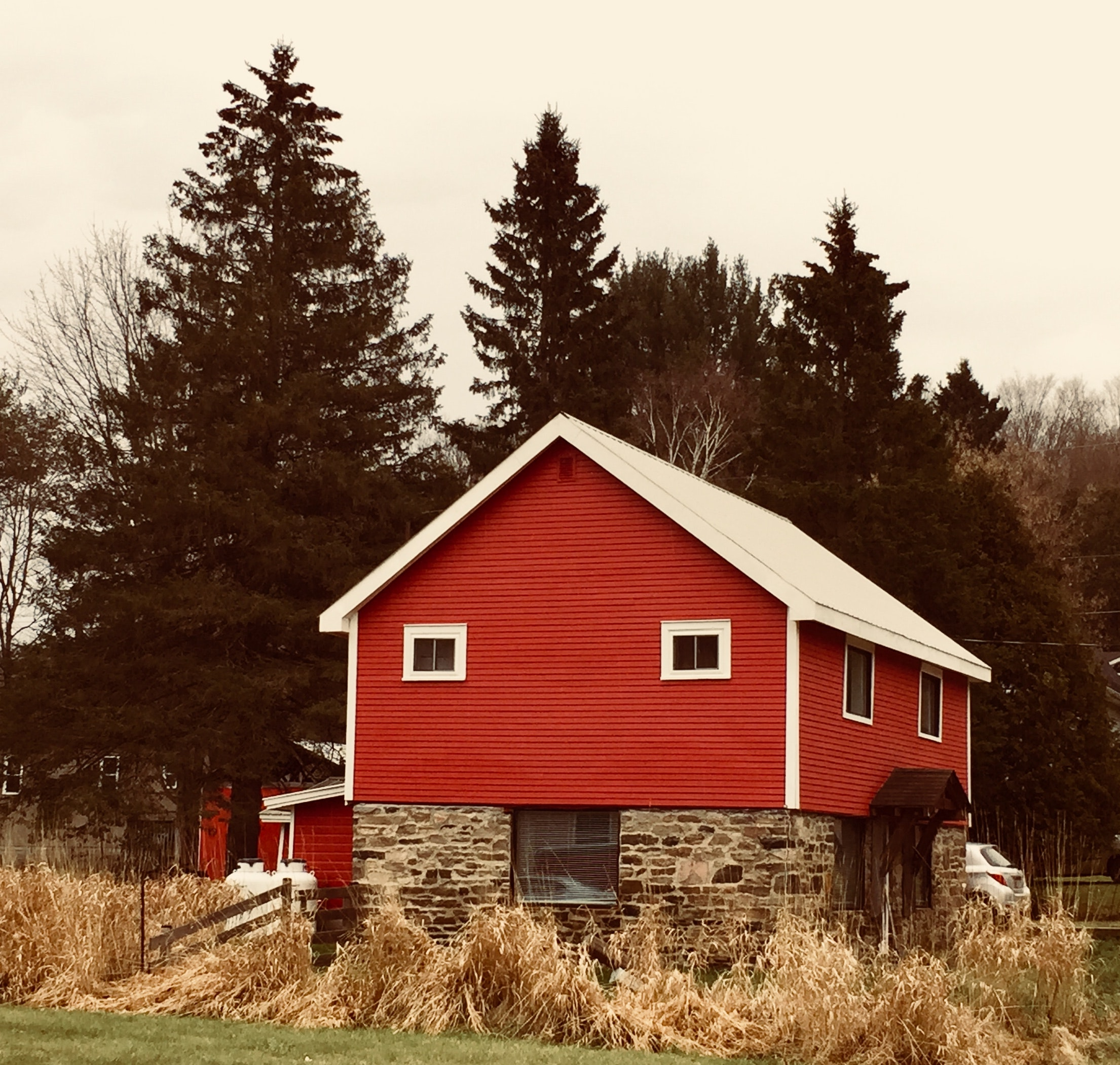 Red, brown, and white wooden and brick house photo
