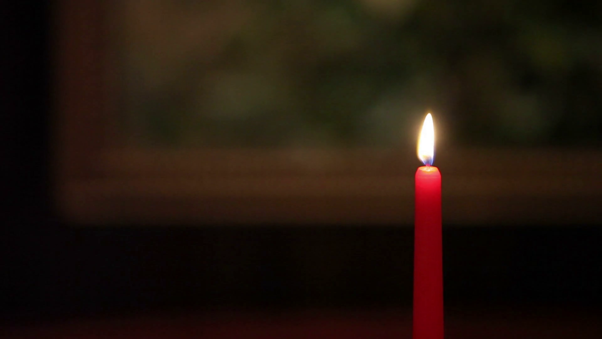 Red candle light in dark room Stock Video Footage - Videoblocks