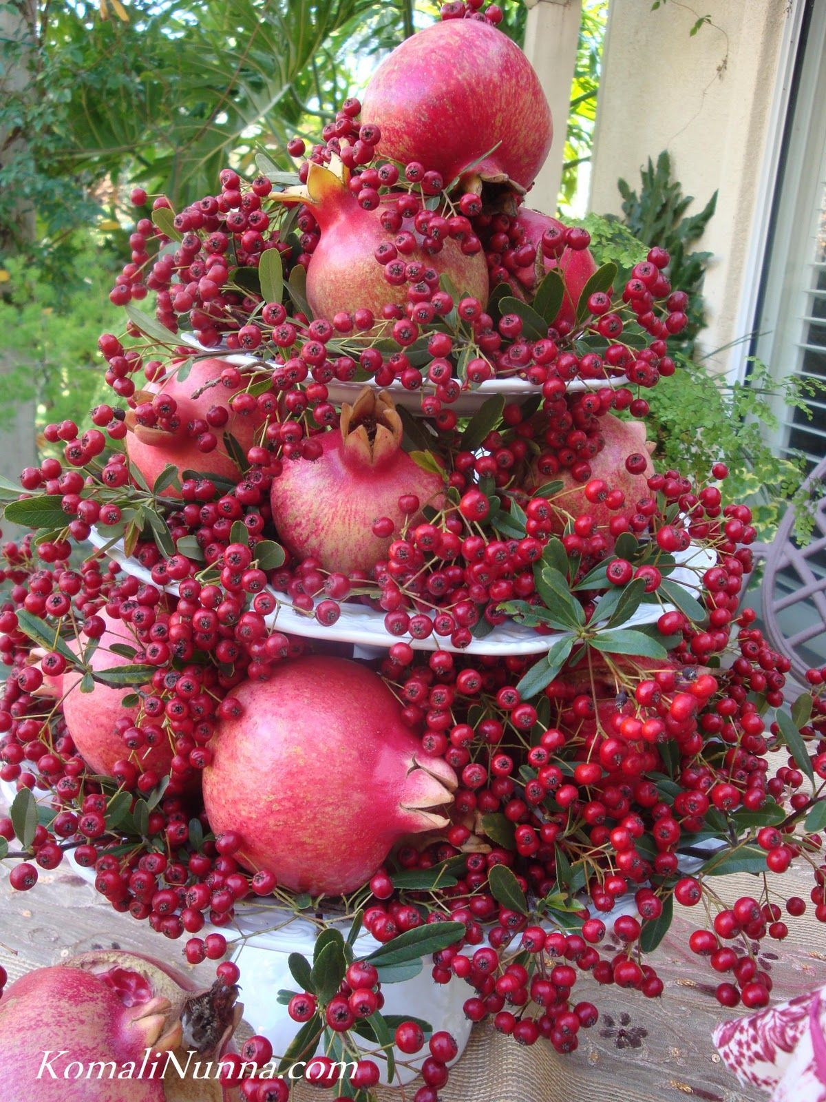 Pomegranate in flower arangements | Pomegranates and berries from ...