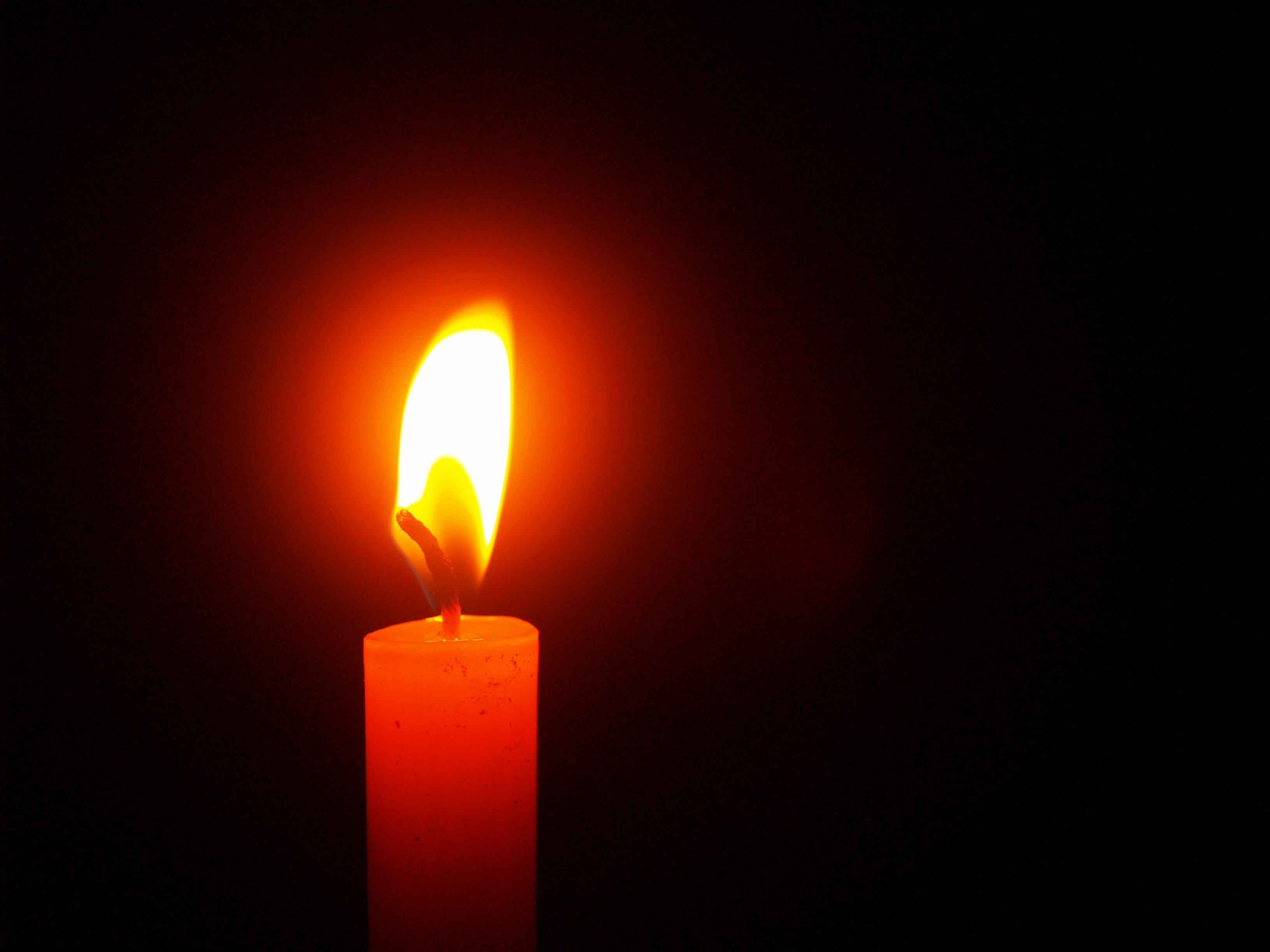 Red Lighted Candle · Free Stock Photo