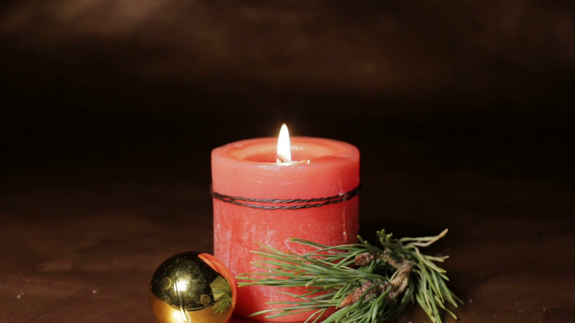 Christmas composition, with lighted red candle, pine sprig and ...