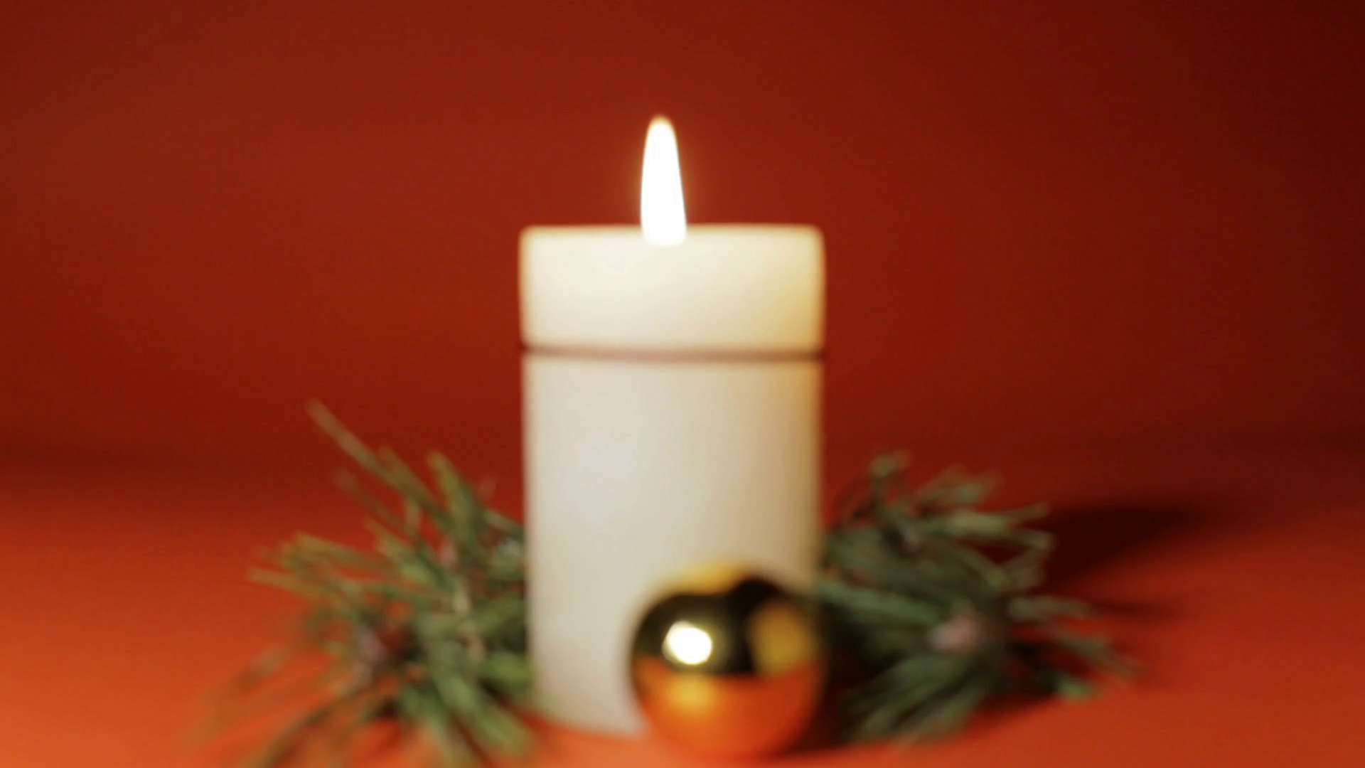 Christmas composition, with lighted white candle, pine branch and ...