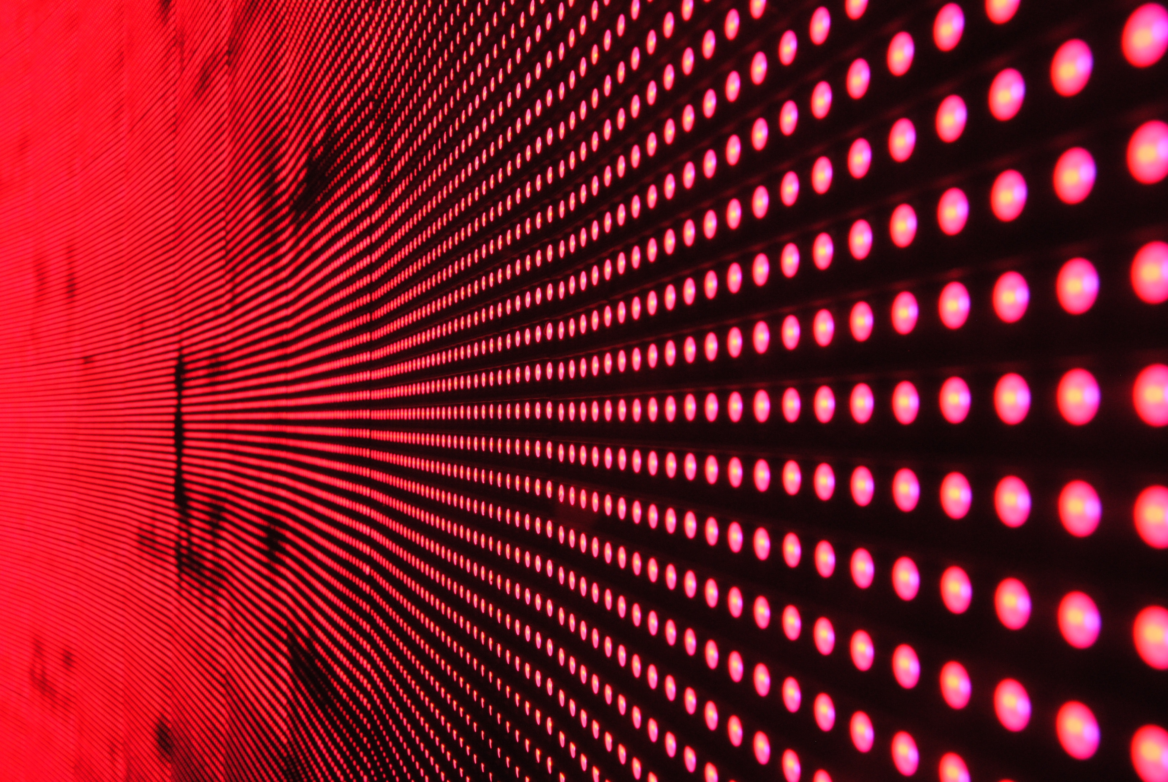 Red lights in line on black surface photo