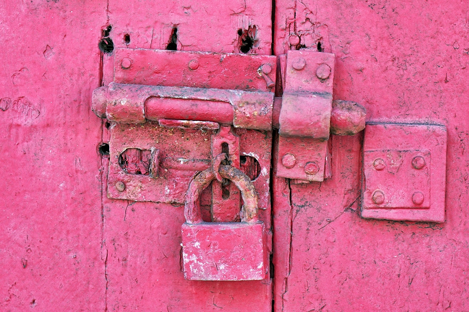 Red metal padlock photo